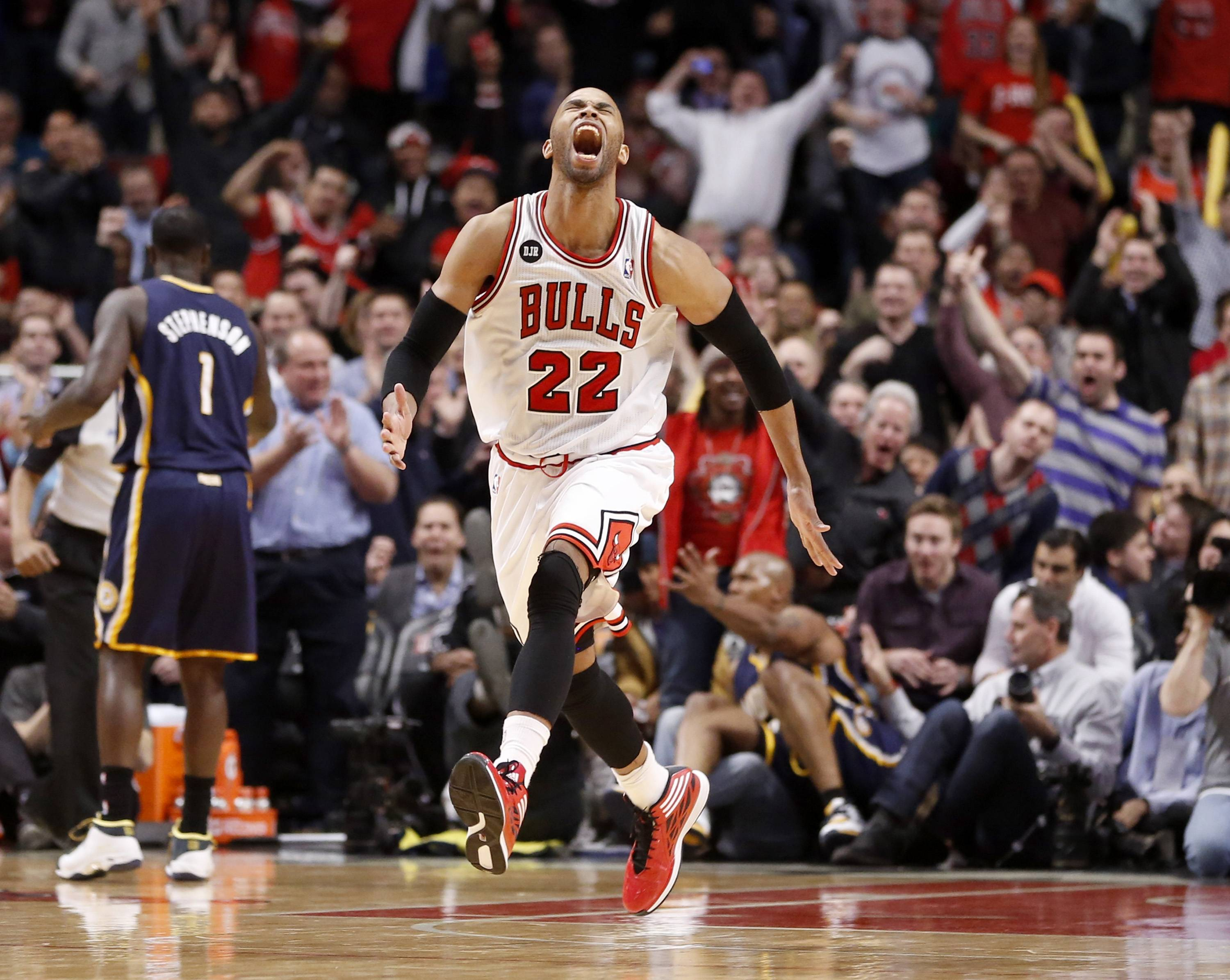 Bulls forward Taj Gibson (22) celebrates after his dunk off a rebound during the second half of an NBA basketball game against the Indiana Pacers Monday, March 24, 2014, in Chicago. The Bulls won 89-77.
