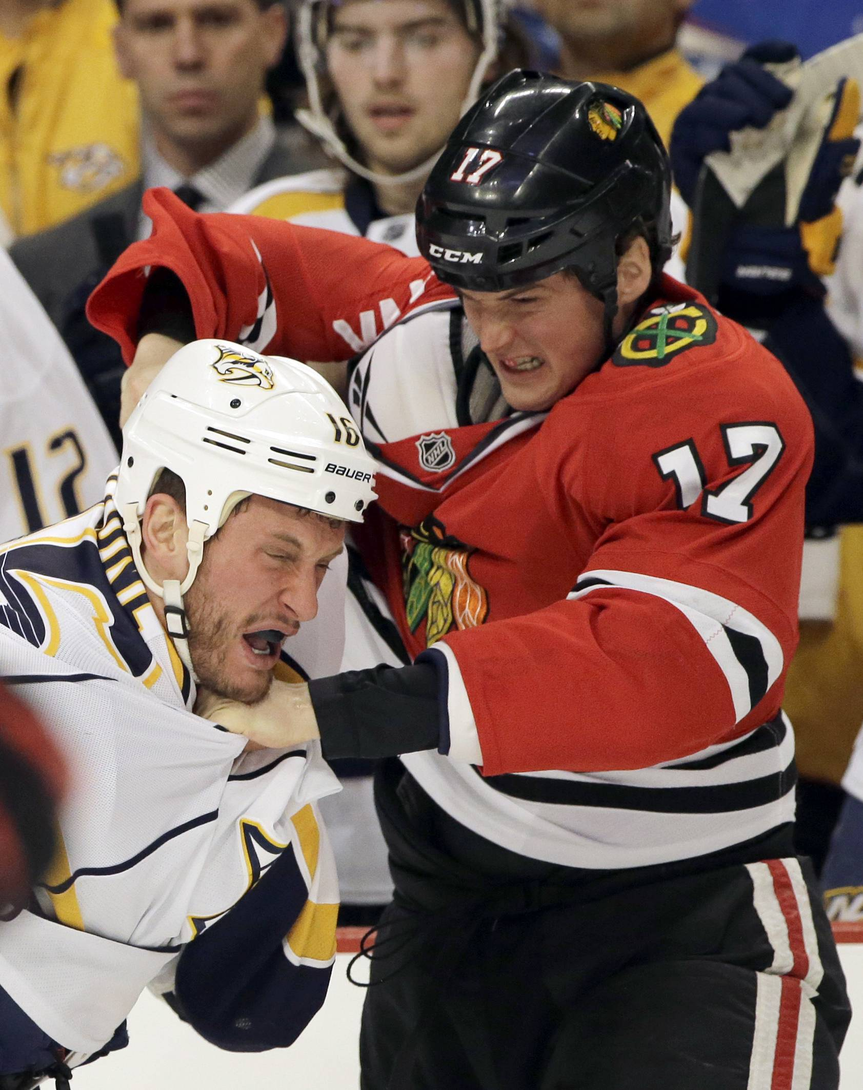 The Blackhawks' Sheldon Brookbank squares off with the Predators' Rich Clune during Sunday's game at the United Center.