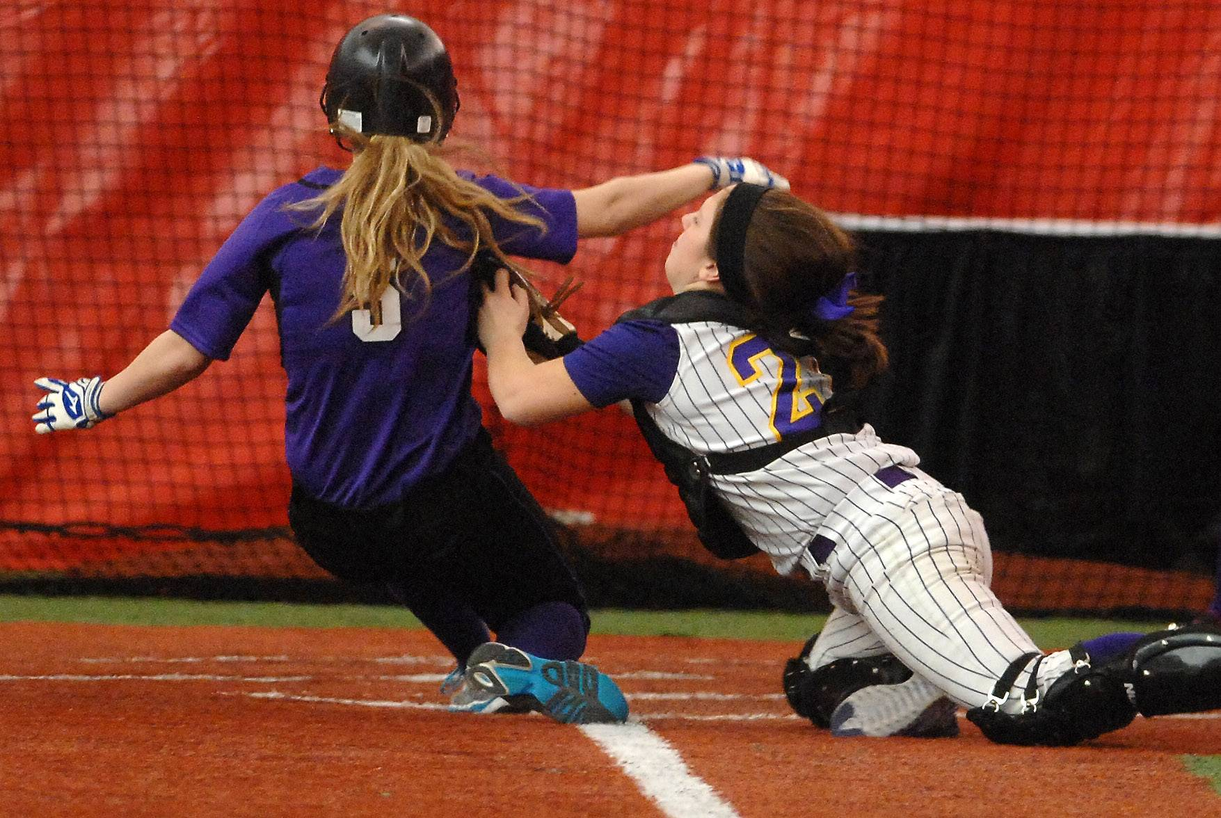 Hampshire's Sara Finn is tagged out at the plate by Wauconda's Taylor McCarthy during game two of doubleheader softball action Monday at The Dome in Rosemont.