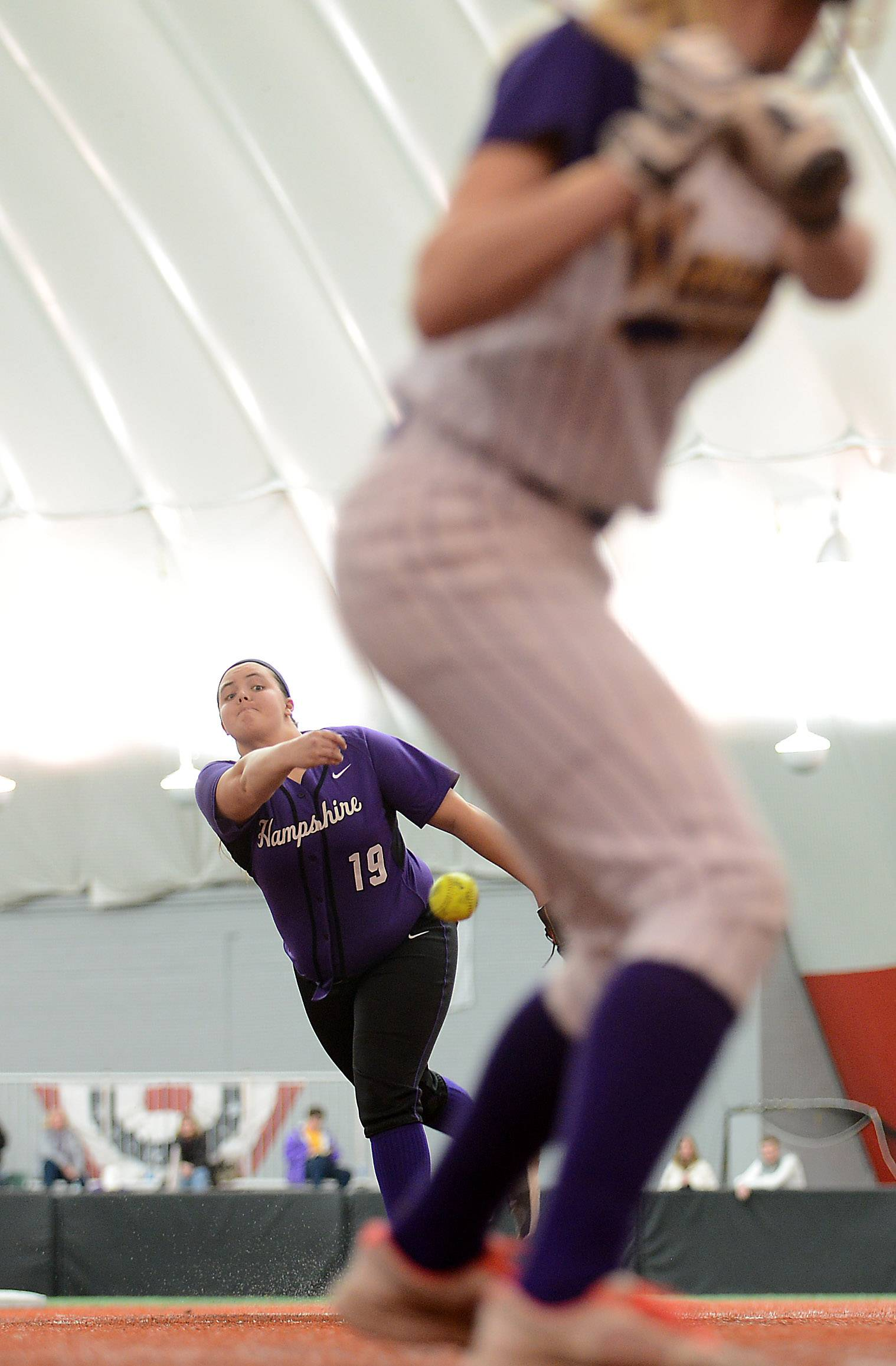 Hampshire's Becca Hurst delivers a pitch during softball action Monday at The Dome in Rosemont.