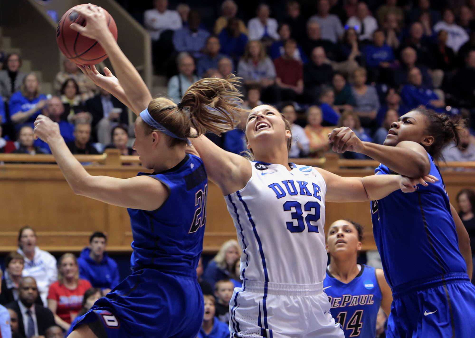 DePaul's Megan Rogowski, left, blocks a shot by Duke's Tricia Liston (32) near DePaul's Brandi Harvey-Carr, right, during the first half of their second-round game in the NCAA basketball tournament in Durham, N.C., Monday, March 24, 2014.
