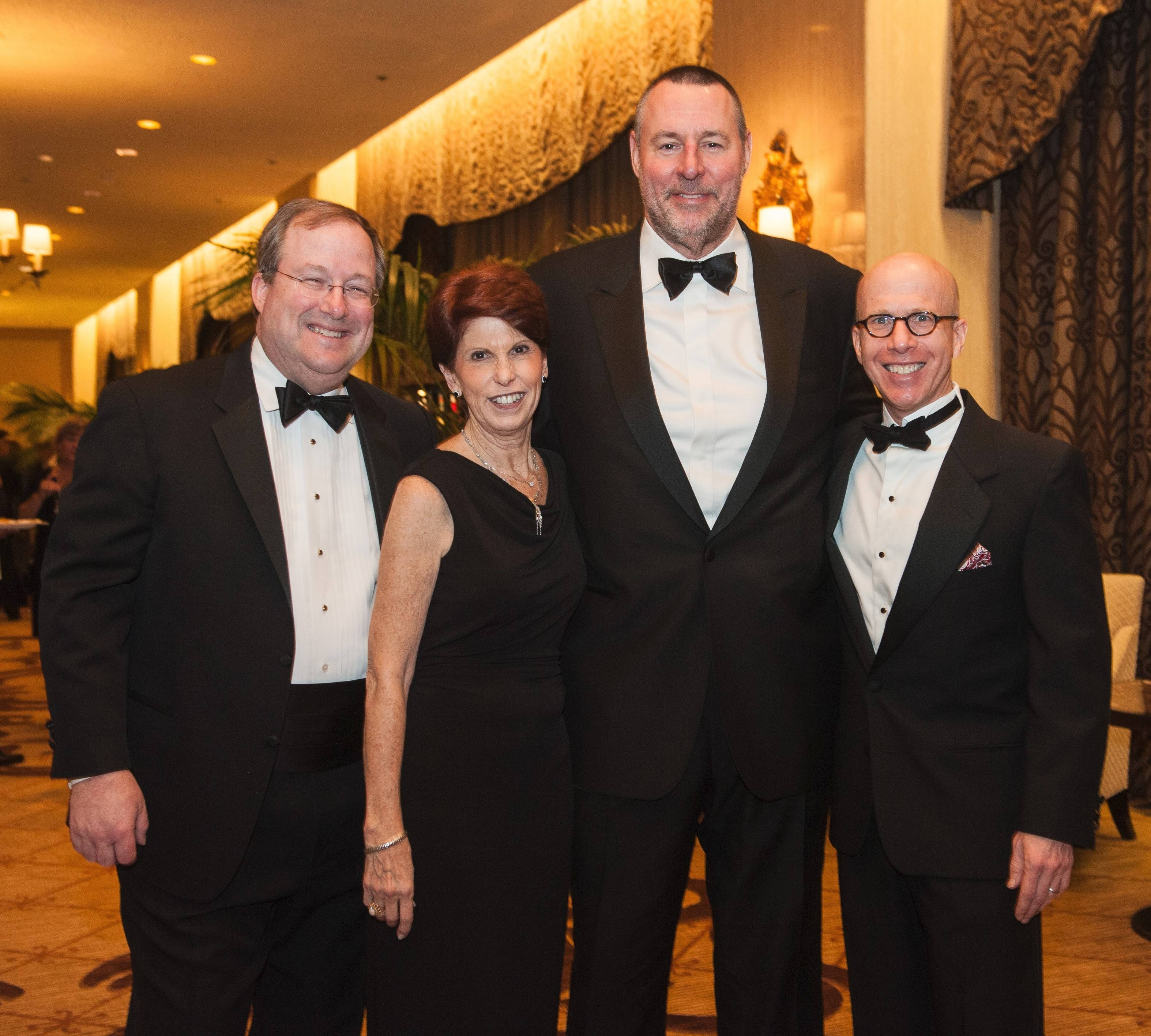 "Wendy Abrams, executive director of the Les Turner ALS Foundation, with foundation spokespeople Lin Brehmer of WXRT, former Chicago Bears player Keith Van Horne and author Jonathan Eig at the ""Hope Through Caring"" award dinner March 15."