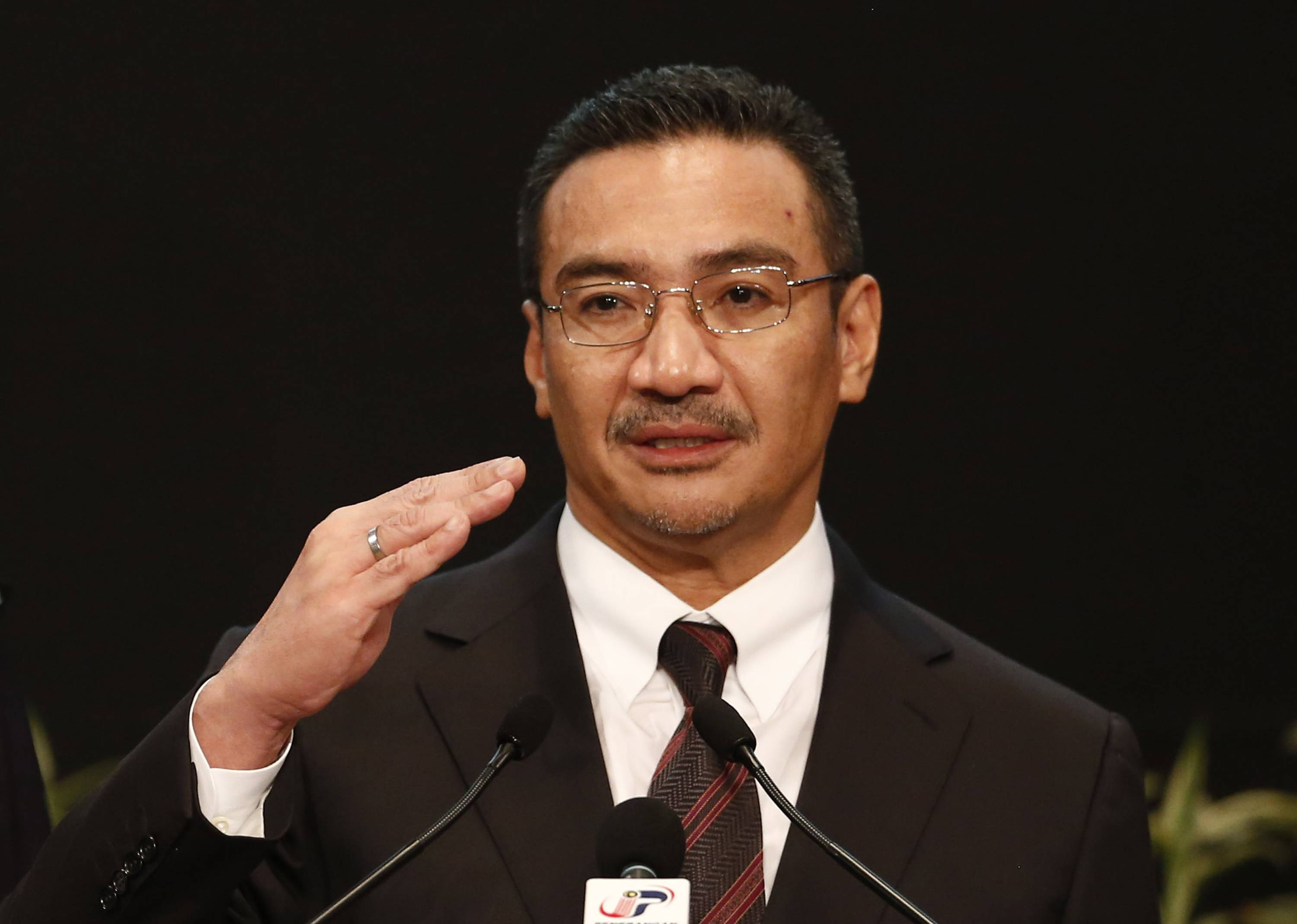 Malaysia's acting Transport Minister Hishammuddin Hussein answers a reporter's questions Tuesday during a news conference for Malaysia Airlines Flight MH370 at Putra World Trade Centre (PWTC) in Kuala Lumpur, Malaysia. China demanded that Malaysia turn over the satellite data used to conclude that a Malaysia Airlines jetliner had crashed in the southern Indian Ocean, killing everyone on board, as gale-force winds and heavy rain on Tuesday halted the search for remains of the plane.