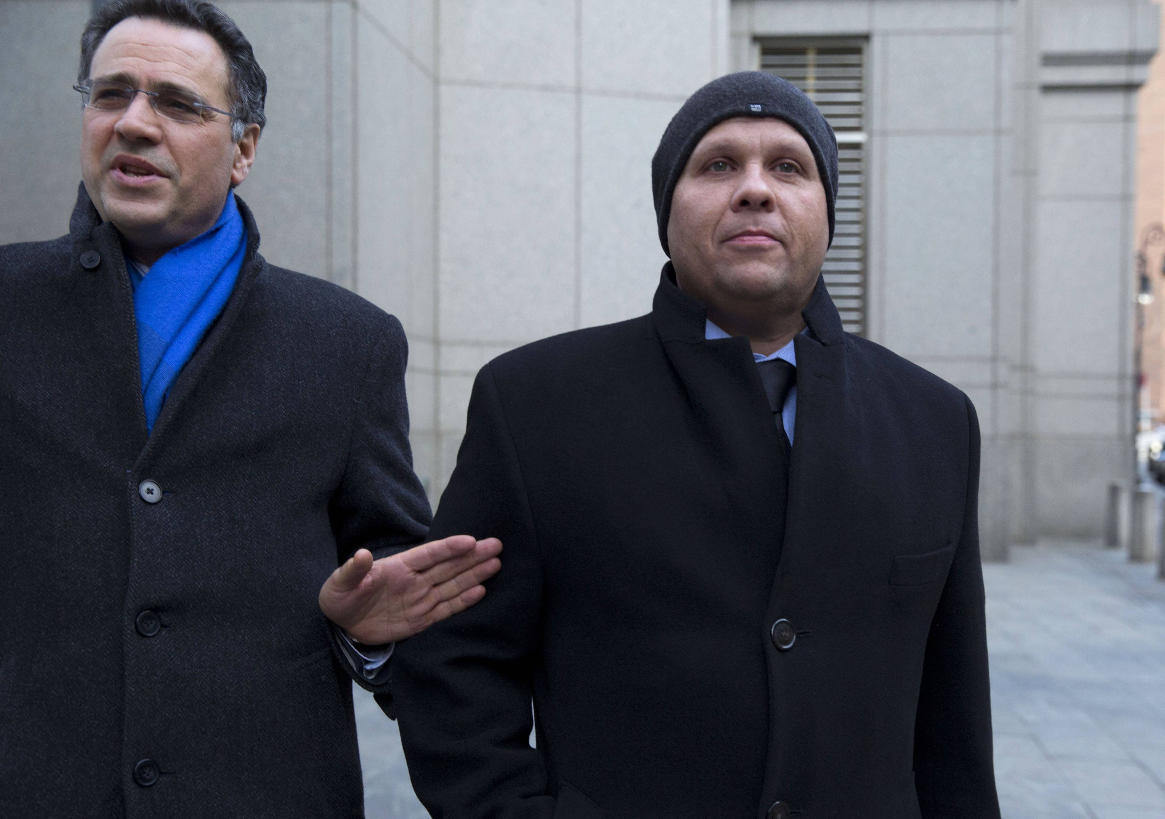 George Perez, a former programmer at Bernard L. Madoff Investments Securities LLC, right, exits federal court in New York on Monday. Five former aides to Bernard Madoff who spent decades working for his firm were found guilty of helping run the biggest Ponzi scheme in U.S. history, a $17.5 billion fraud exposed by the 2008 financial crisis. Perez, along with fellow programmer Jerome O'Hara is accused of automating the scam as it grew rapidly in the 1990s.