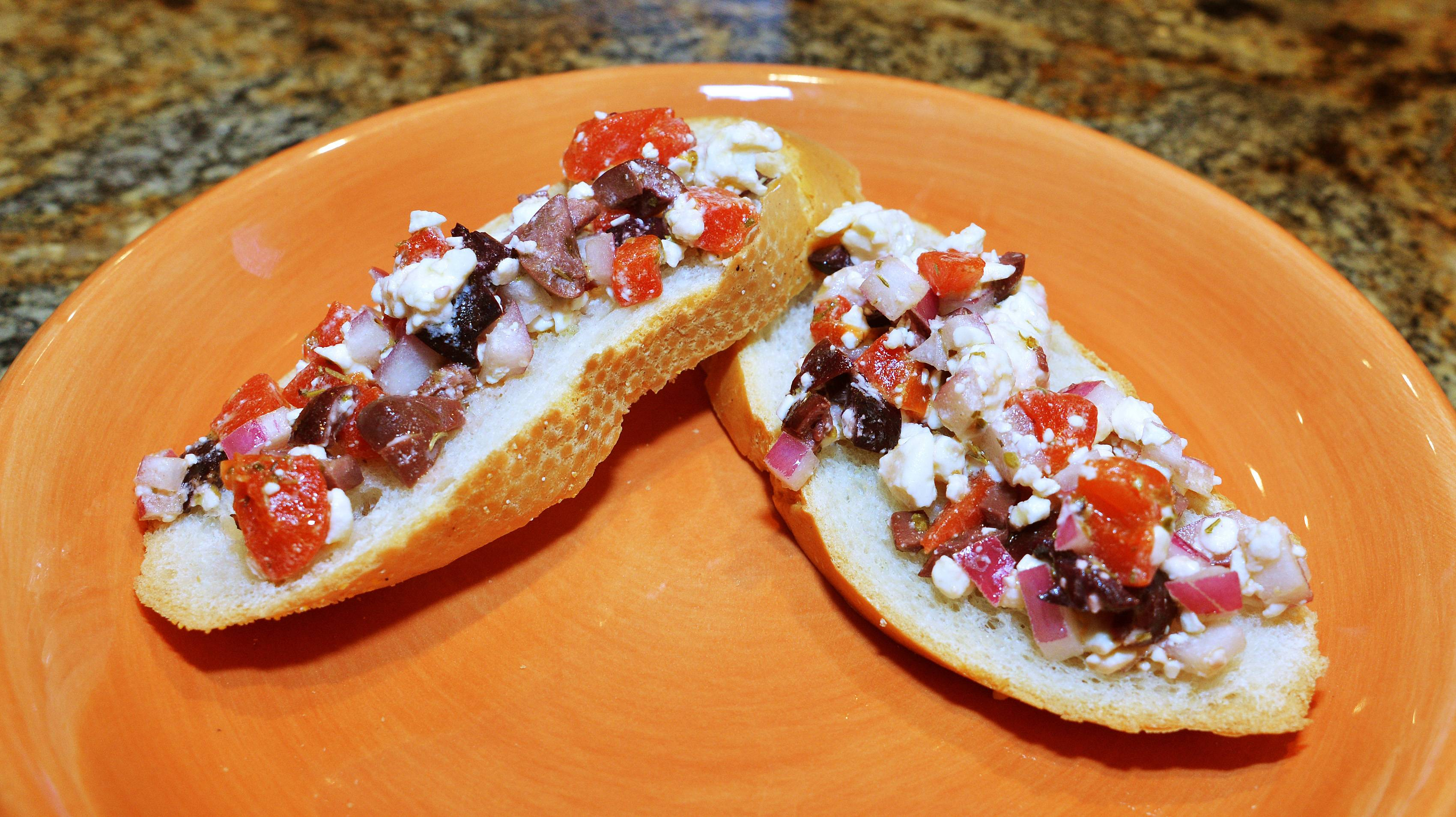 Kalamata olives and feta cheese go into Cook of the Week Christine Crabtree's Greek Bruschetta.
