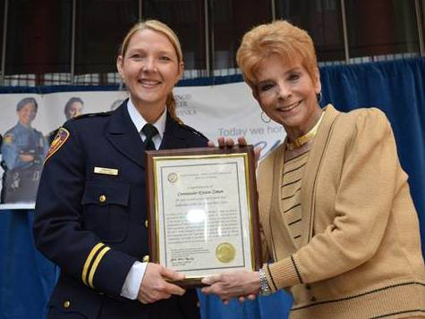 Illinois Comptroller Judy Baar Topinka, right, honored female law enforcement leaders, including Aurora Police Department Commander Kristen Ziman as part of Women's History Month.