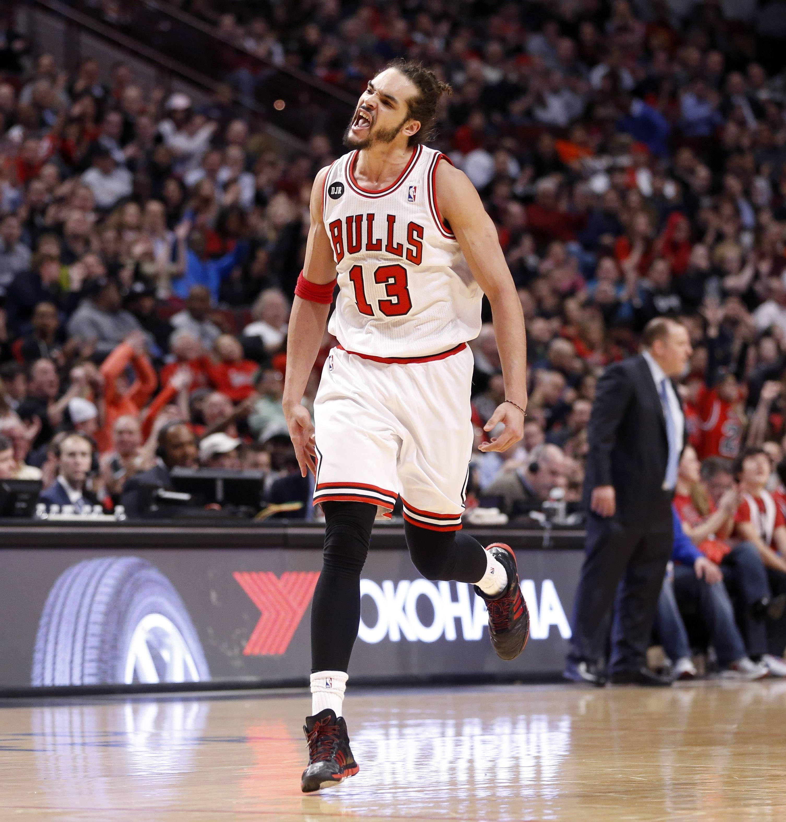 Chicago Bulls center Joakim Noah (13) celebrates the Bulls' expanding lead on the Indiana Pacers during the second half of an NBA basketball game Monday, March 24, 2014, in Chicago. The Bulls won 89-77. (AP Photo/Charles Rex Arbogast)