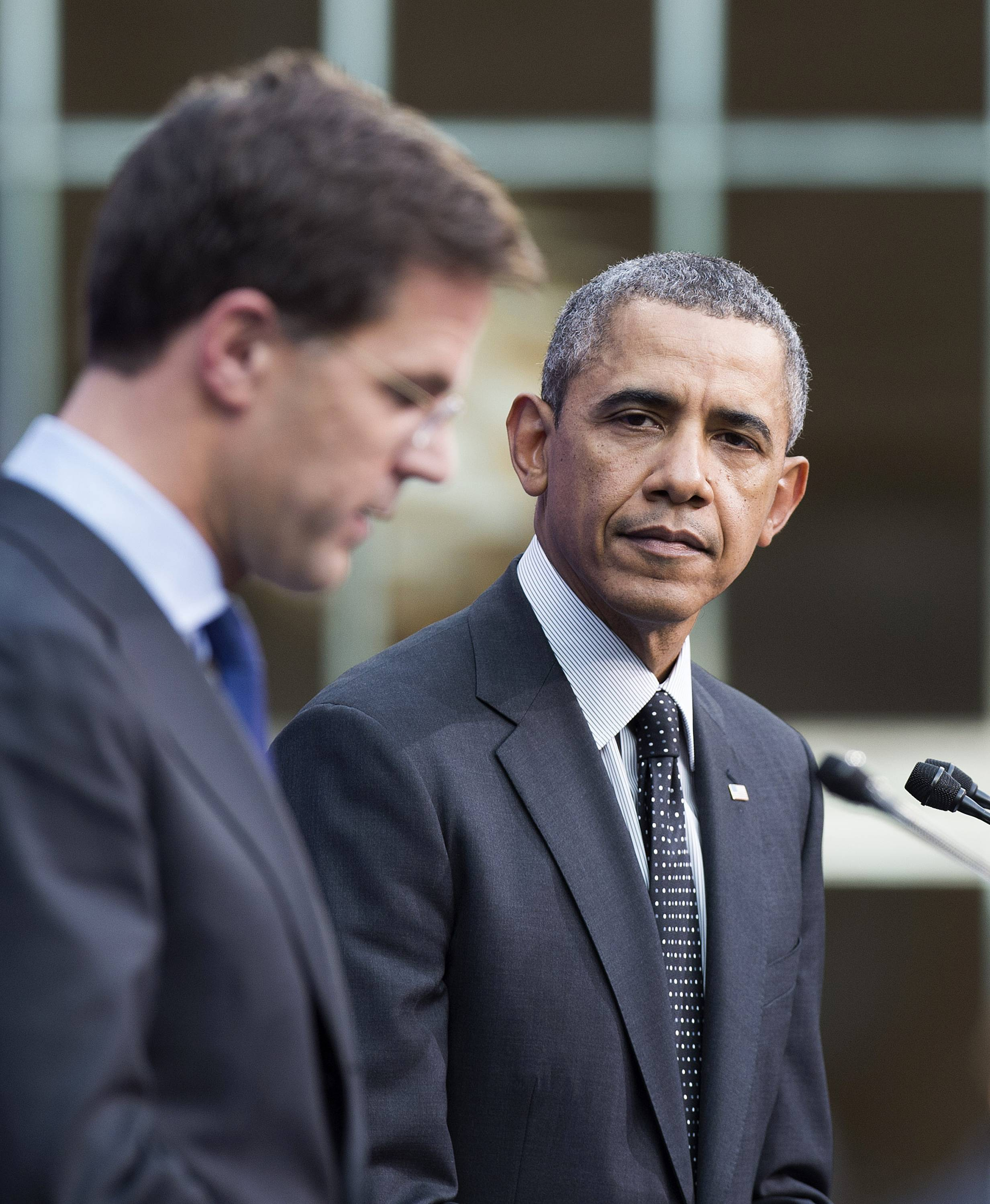 "President Barack Obama looks on as Dutch Prime Minister Mark Rutte speaks at a press conference after the Nuclear Security Summit in The Hague, Netherlands, Tuesday. Obama hailed a ""fundamental shift"" in international efforts to fight nuclear terrorism,"