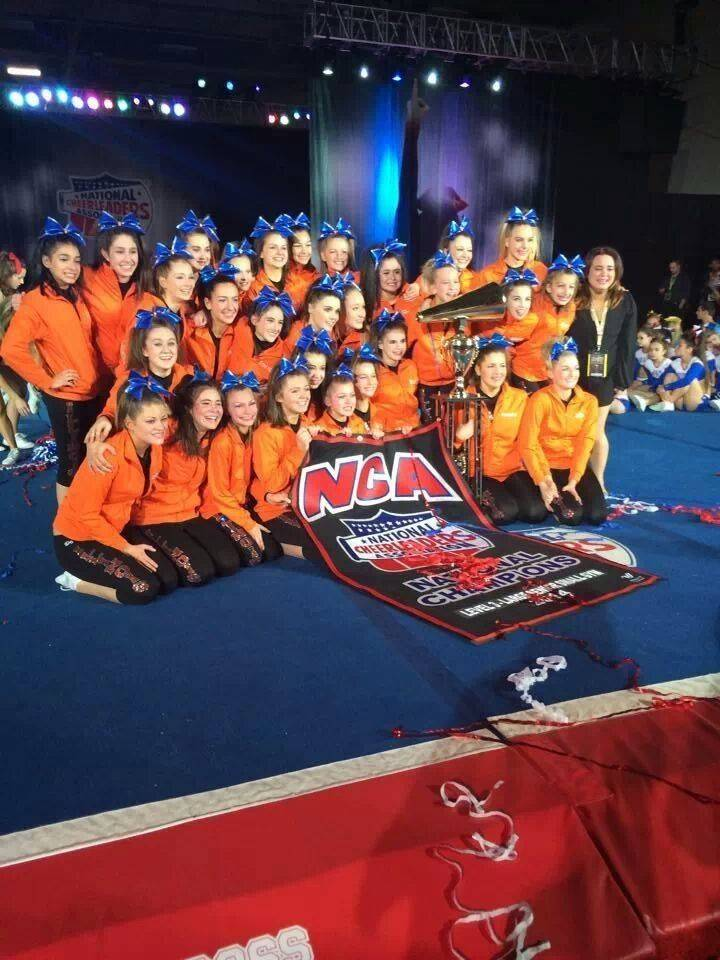 The Lady Queens celebrate their big win at the NCA Dallas championships.