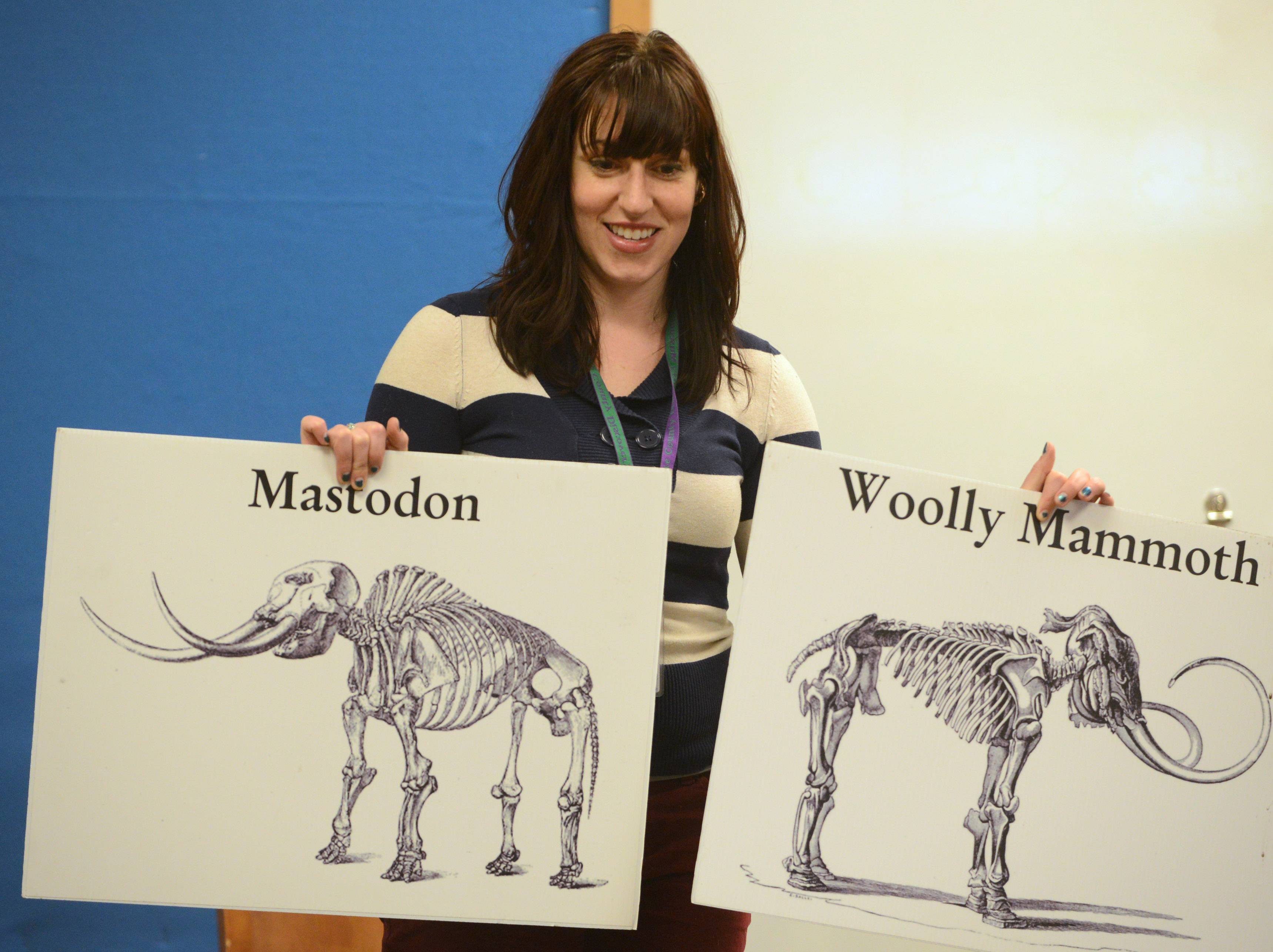 Lake County Discovery Museum educator Nicole Stocker asks the audience to make comparisons between a mastodon and a woolly mammoth Tuesday during the Mighty Mastodons program at Ela Area Public Library in Lake Zurich.