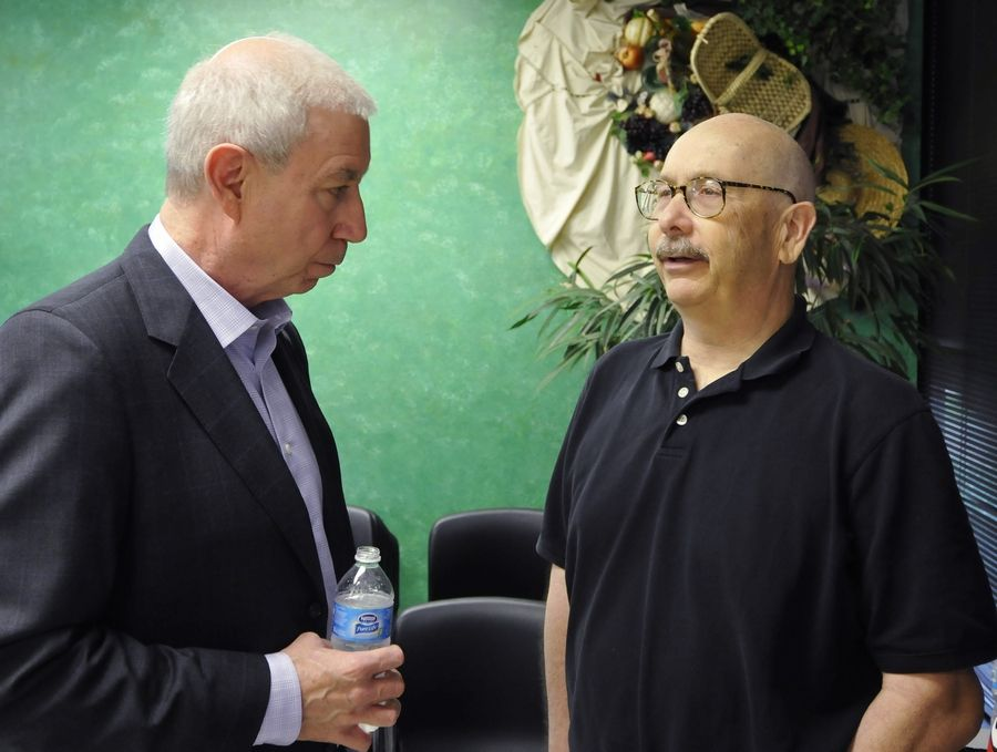 Blackhawks writer Tim Sassone chats last summer with team President John F. McDonough when the Stanley Cup stopped by the Daily Herald.