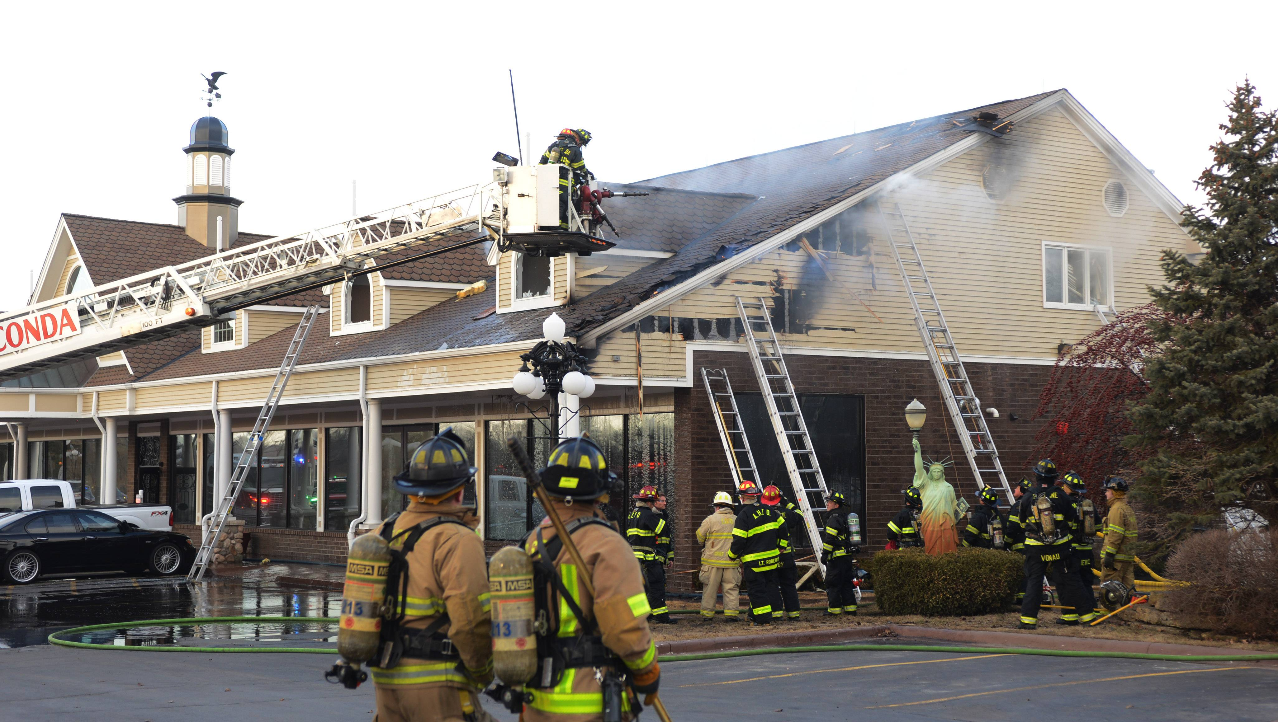 Firefighters on the scene Monday afternoon at Midwest Motors in Lake Zurich. Fire broke out on the second floor at the south end of the building.