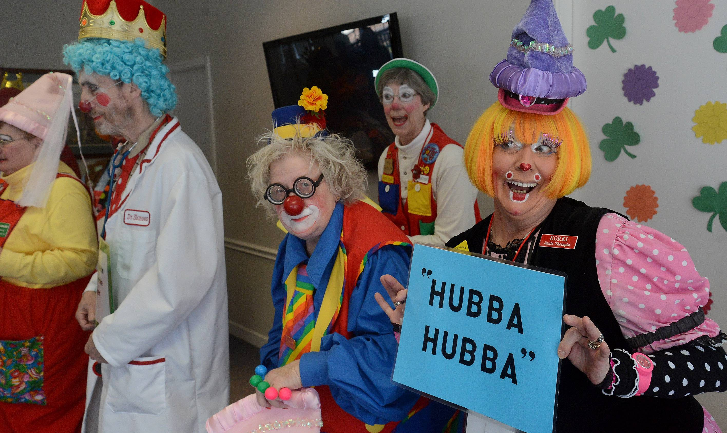 An assortment of clowns bring cheer to patients in the Arden Courts of Northbrook, shaking hands and doing a few skits.