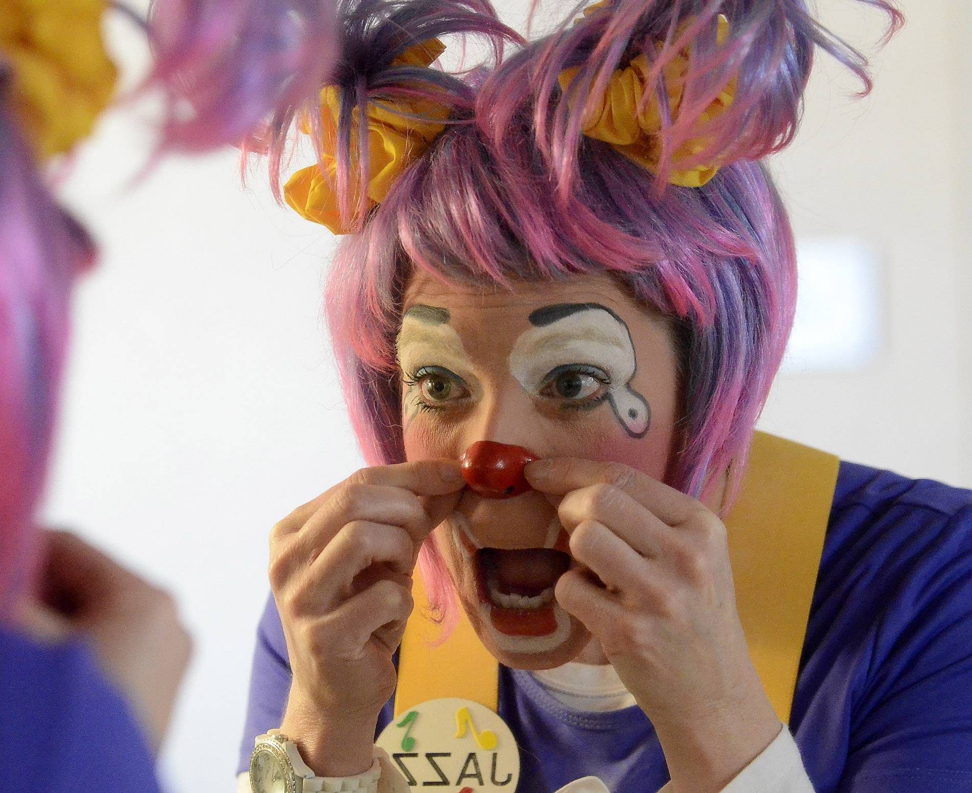 """We're not people,"" says Patti Ummel, putting on the final touches of Jazzi's physical persona. ""We're clowns."""