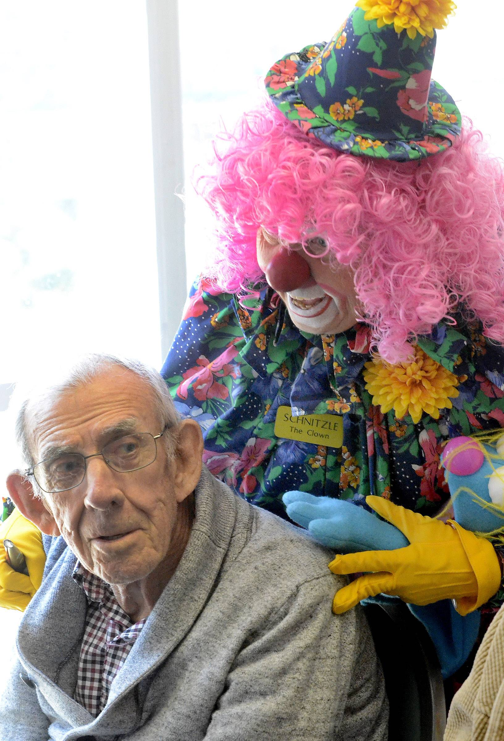 Schnitzle the clown entertains Tony Weller, as 20 clowns in town for the convention visit Alzheimer's patients Monday in the Arden Courts of Northbrook.