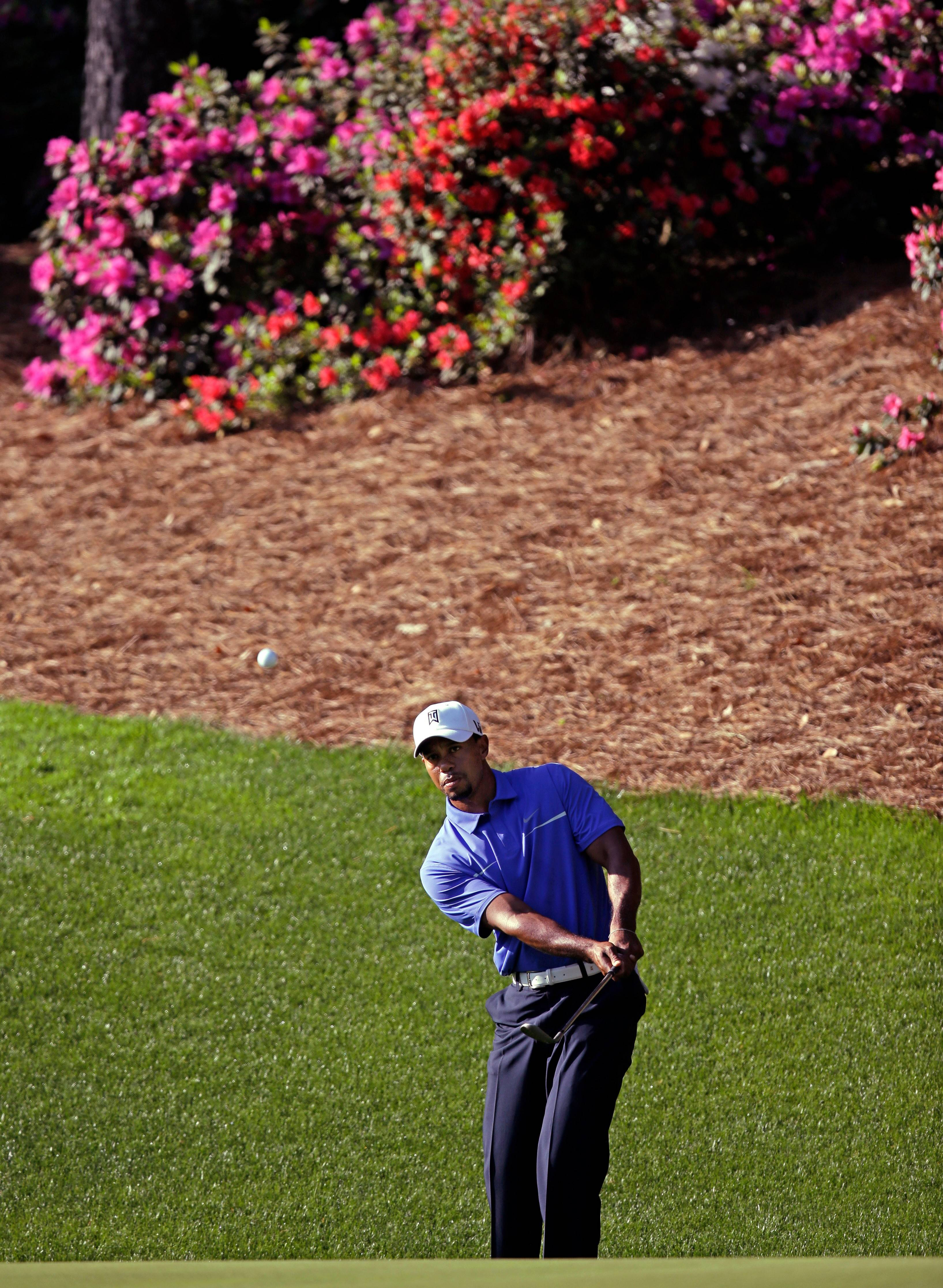 Tiger Woods, here chipping to the 13th green at Augusta National last spring, may have to skip the Masters due to a sore back.