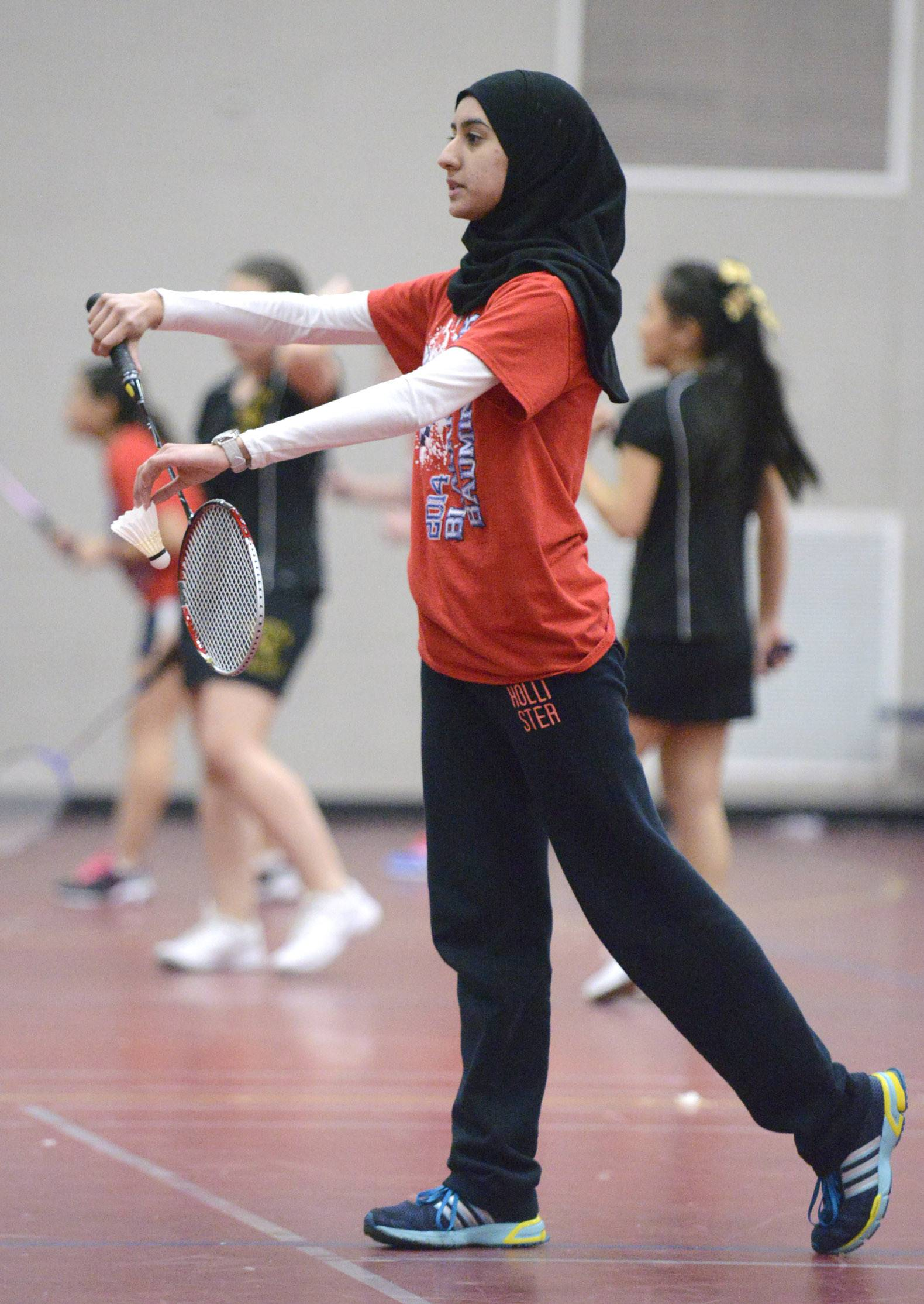 West Aurora's Hiba Shahid serves to Metea Valley in the first doubles match at West Aurora High School on Tuesday, March 25.