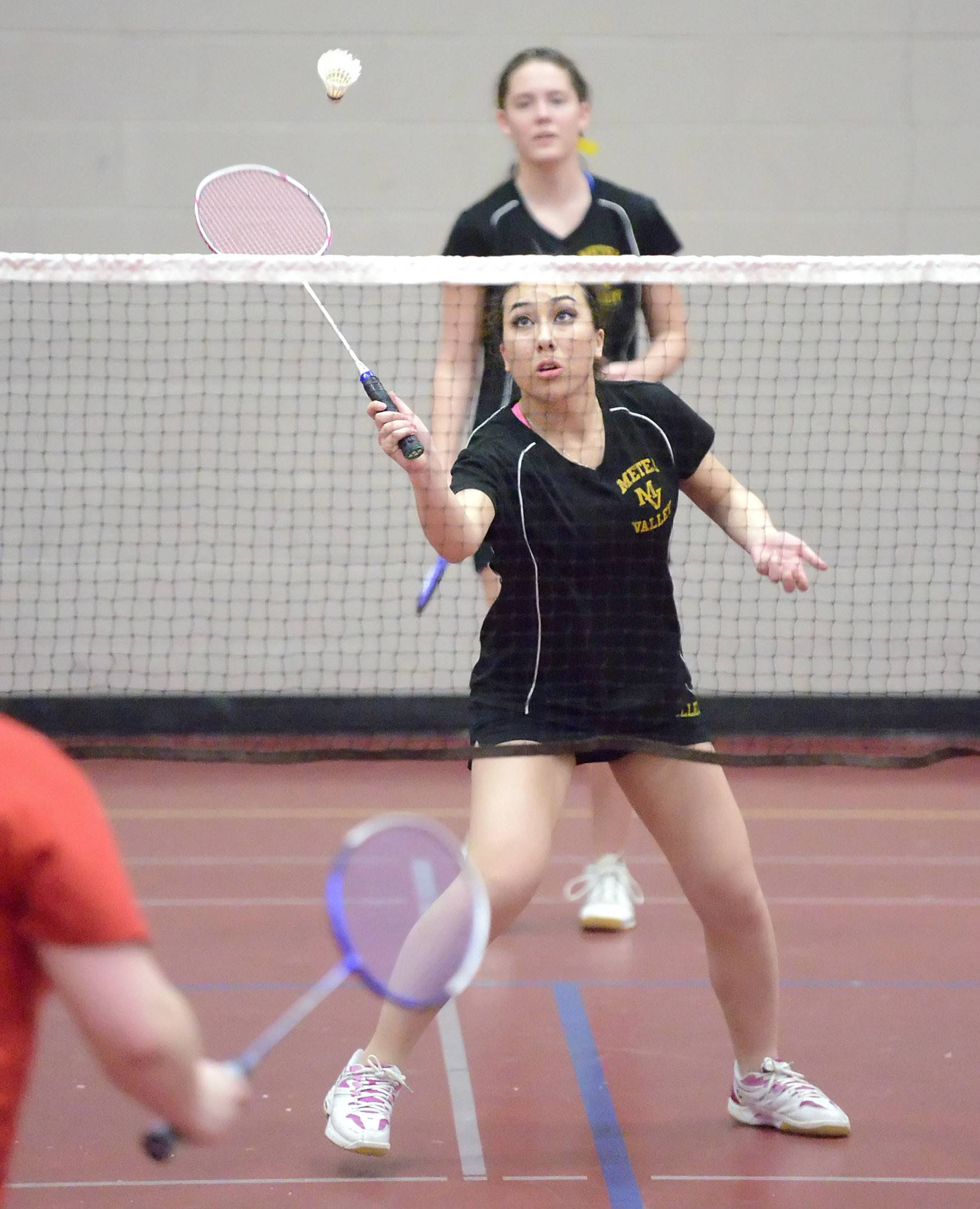 Metea Valley's Alyssa Funk (front) returns a serve from West Aurora in the first doubles match with partner Emily Dixon at West Aurora High School on Tuesday, March 25.