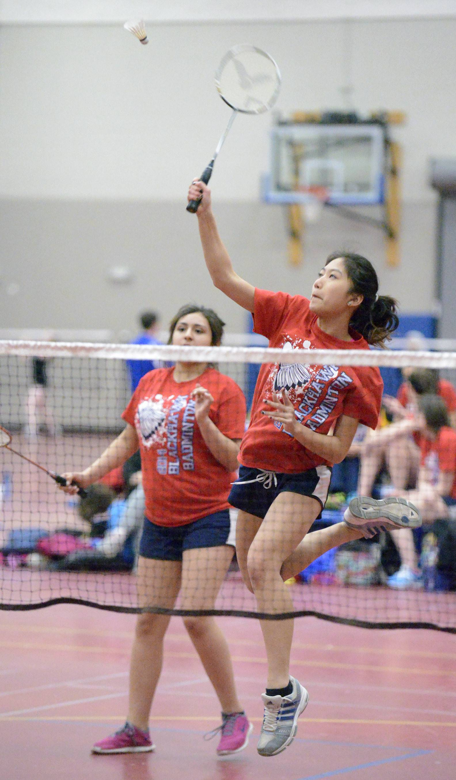 West Aurora's Zsa Zsa Quach returns a serve from Metea Valley while playing second doubles with her partner Krystal Diaz Tuesday in Aurora.