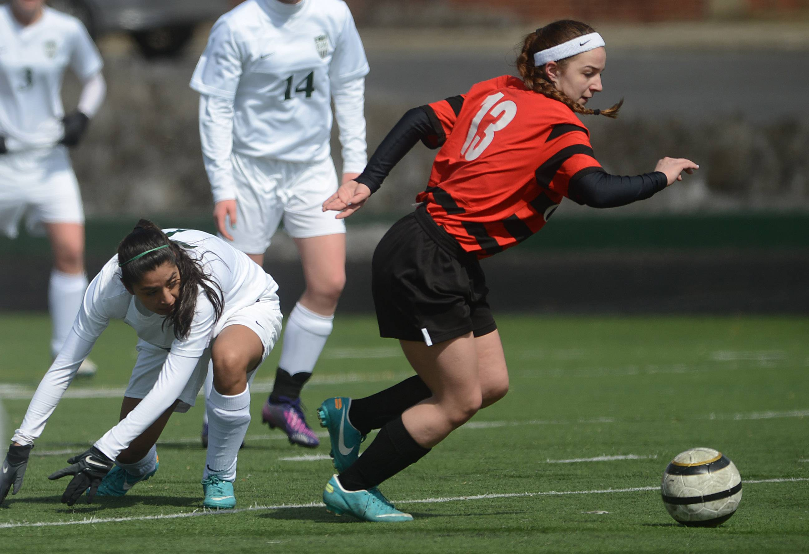 Grant's Jenna Pecorini (13) gets the upper hand on Grayslake Central's Karleen Gomez during Tuesday's soccer game in Grayslake.
