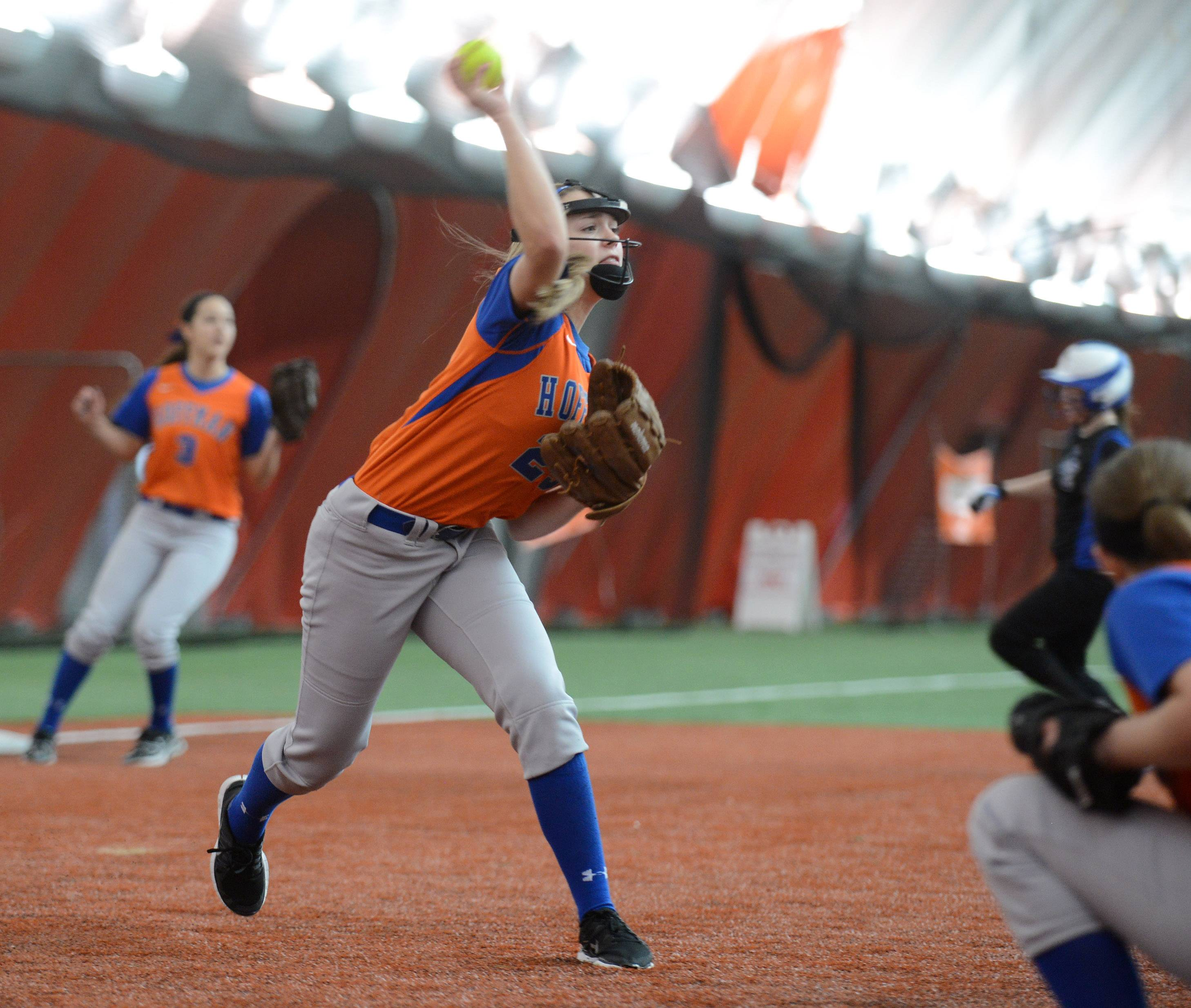 Hoffman Estates' Jordyn Fera fires to first after fielding a Lake Zurich bunt during softball action Tuesday in Rosemont.