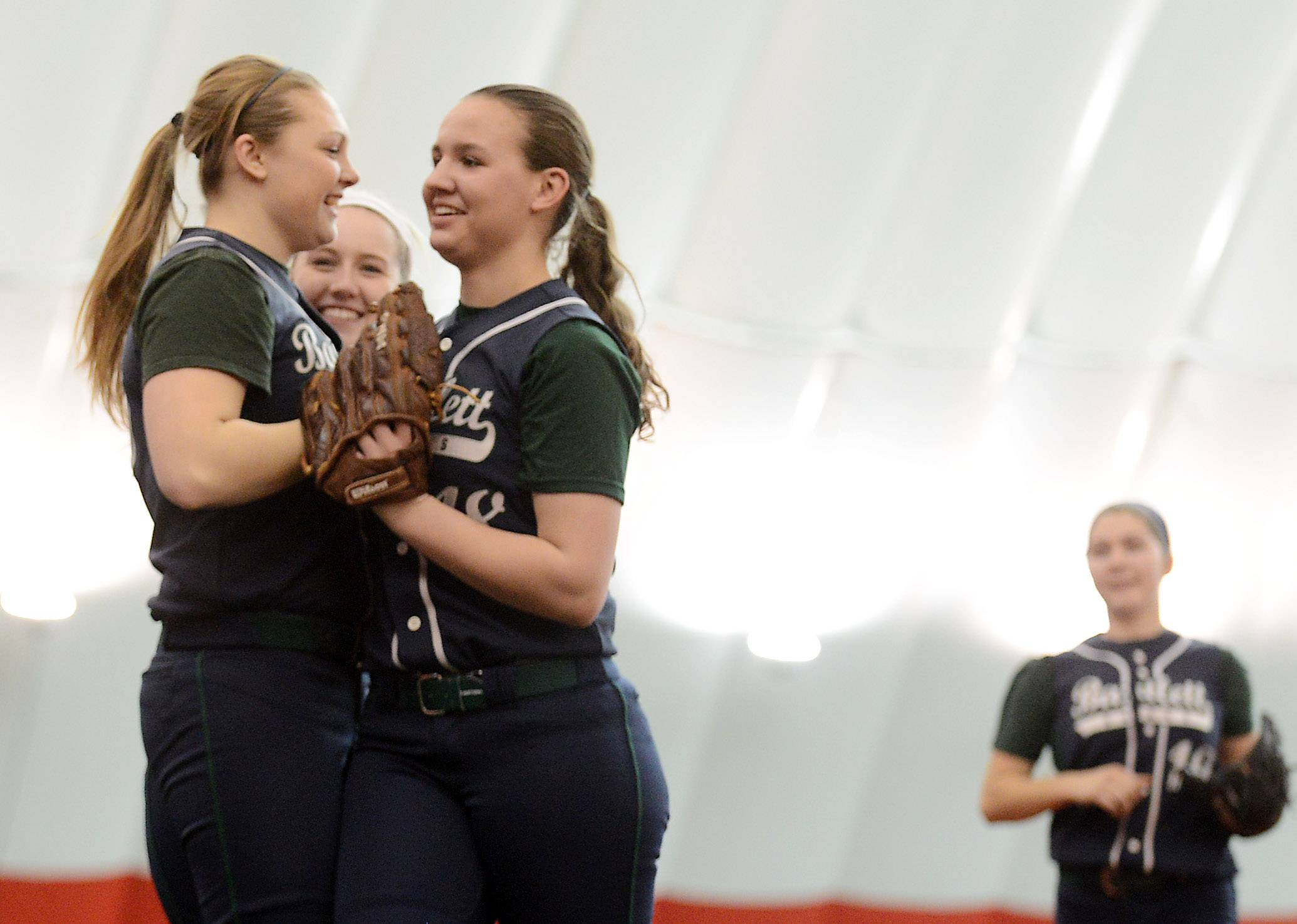 Bartlett's Holly Pagan, left, greets pitcher Alyssa Nowak as she comes off the field after recording the final out in their comeback win against Plainfield Central during softball action Tuesday in Rosemont.