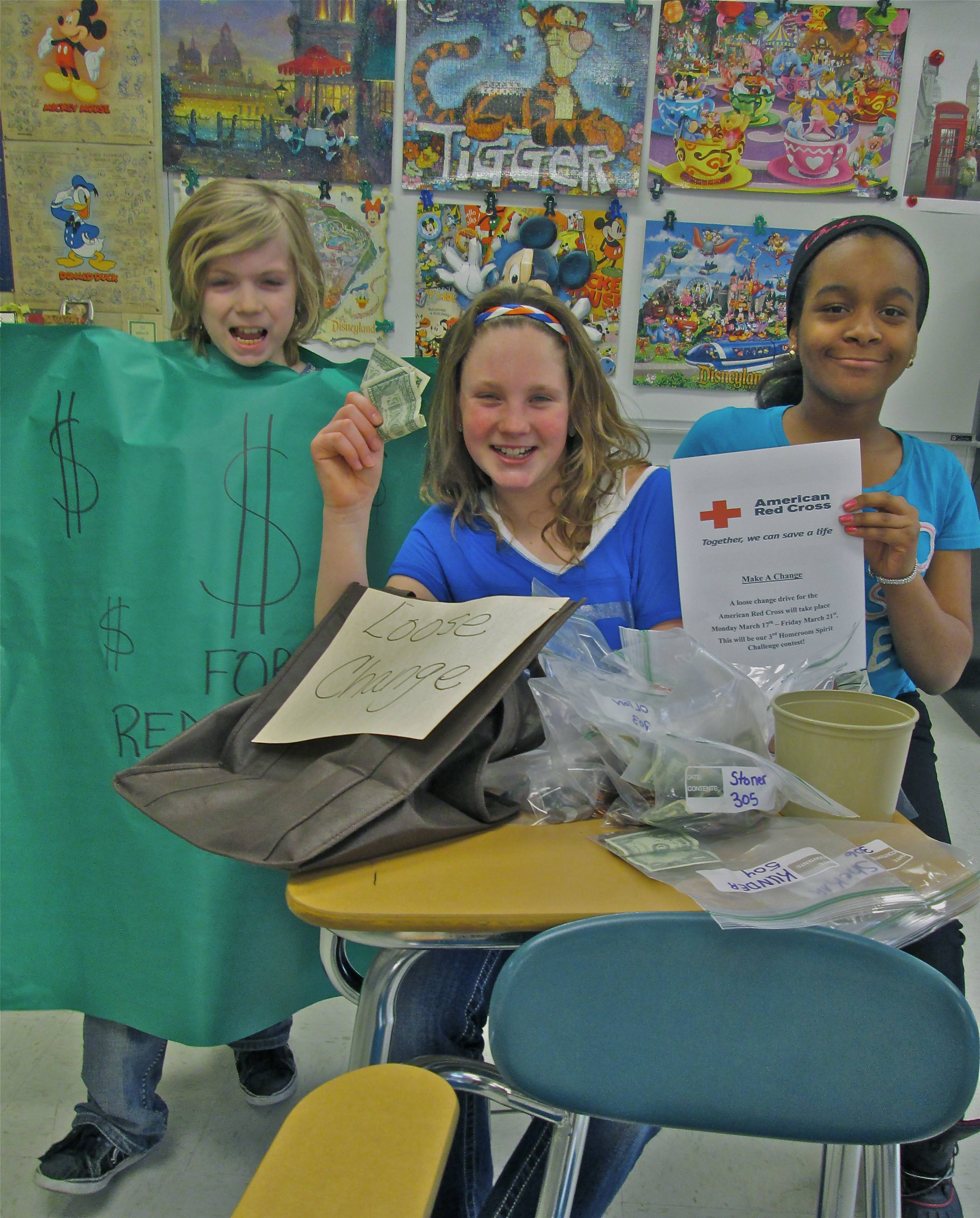 "Glen Crest Student Union members, sixth graders Zac Harmon ""Lucky Buck,"" Grace Wallner and Dekyia Nichols spent volunteer time after school on Friday, March 21 to help the co -sponsors Rose D'Eccliss and Kathy Mansfield, count the loose change.   Jean Jeske"