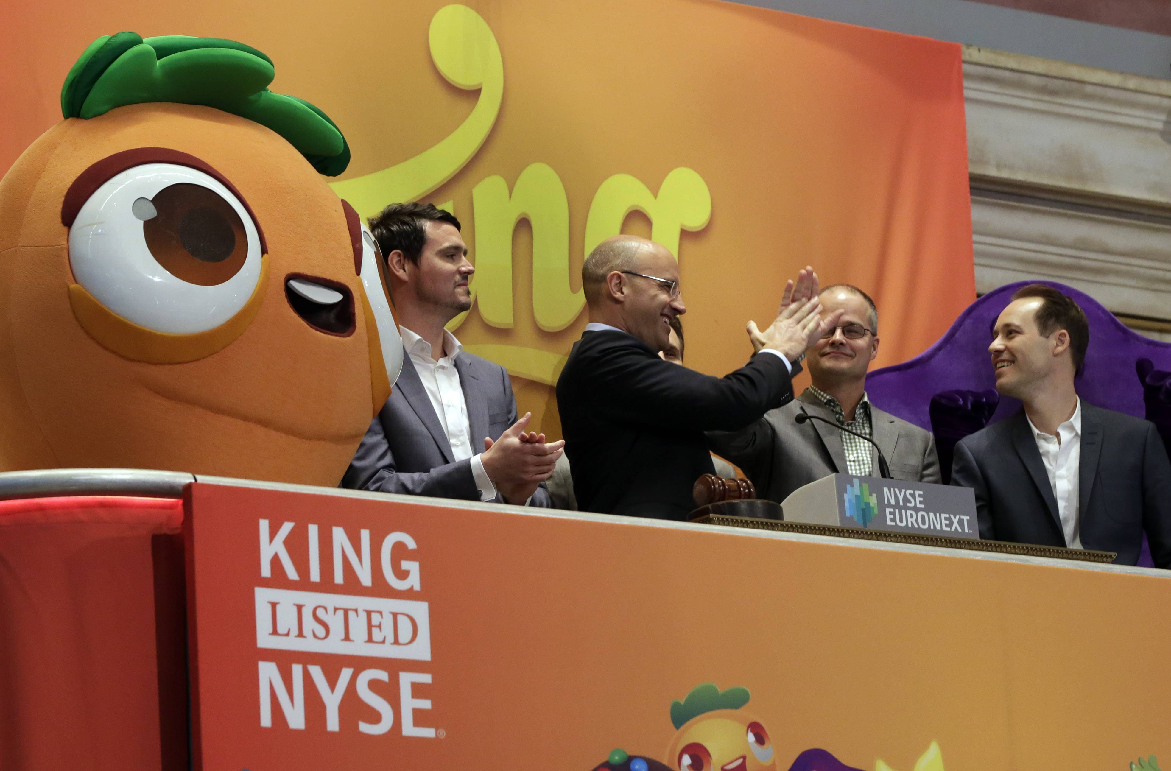 King Digital Entertainment CEO and founder Riccardo Zacconio second left, high-fives with company co-founder Lars markgren, the maker of Candy Crush Saga and Farm Heroes Saga, during opening bell ceremonies at the New York Stock Exchange, before King Digital's IPO, Wednesday. The company flopped in its market debut.