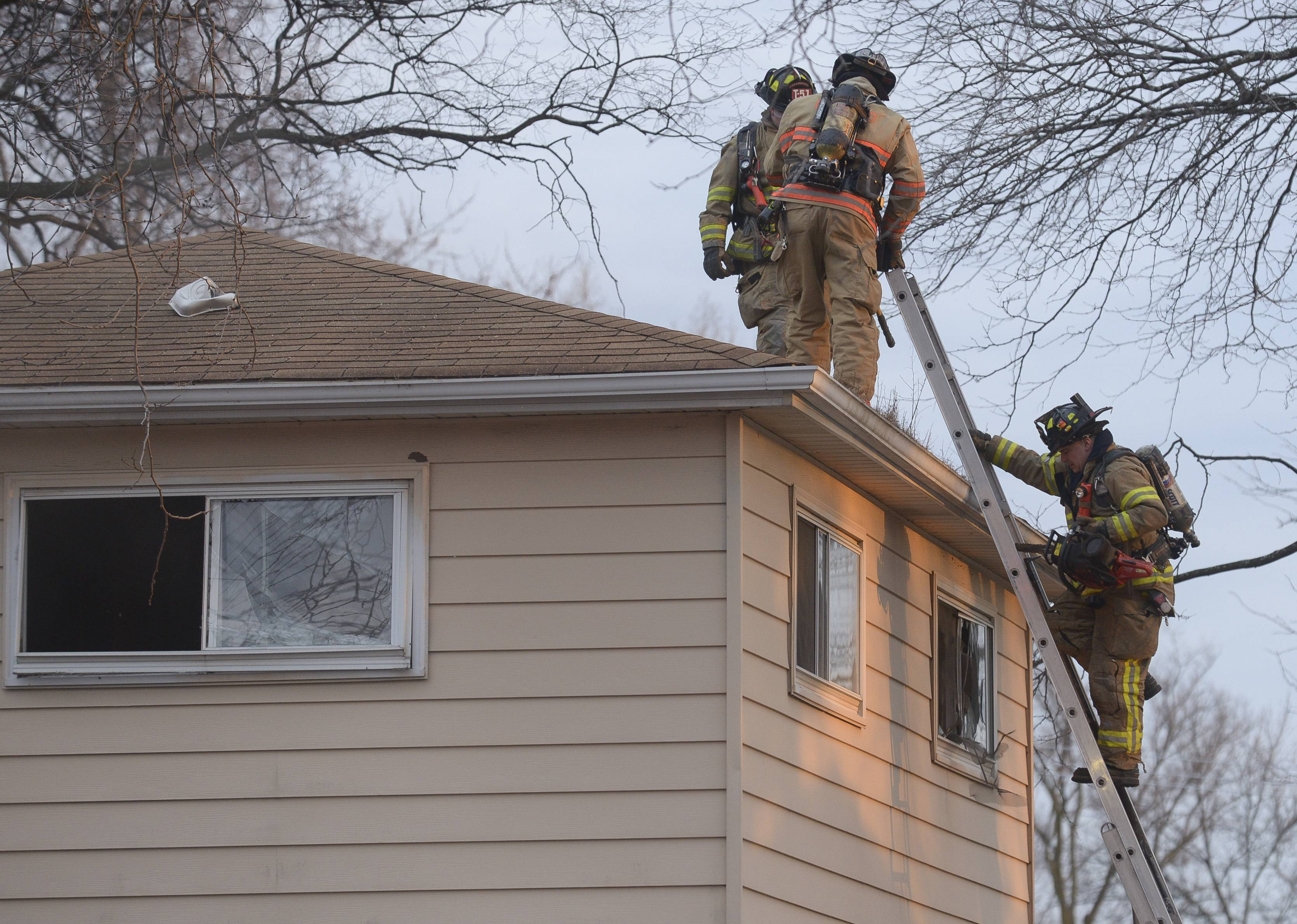 The Lombard fire department works the scene of a house fire in the 200 block of west Central Avenue in Lombard.