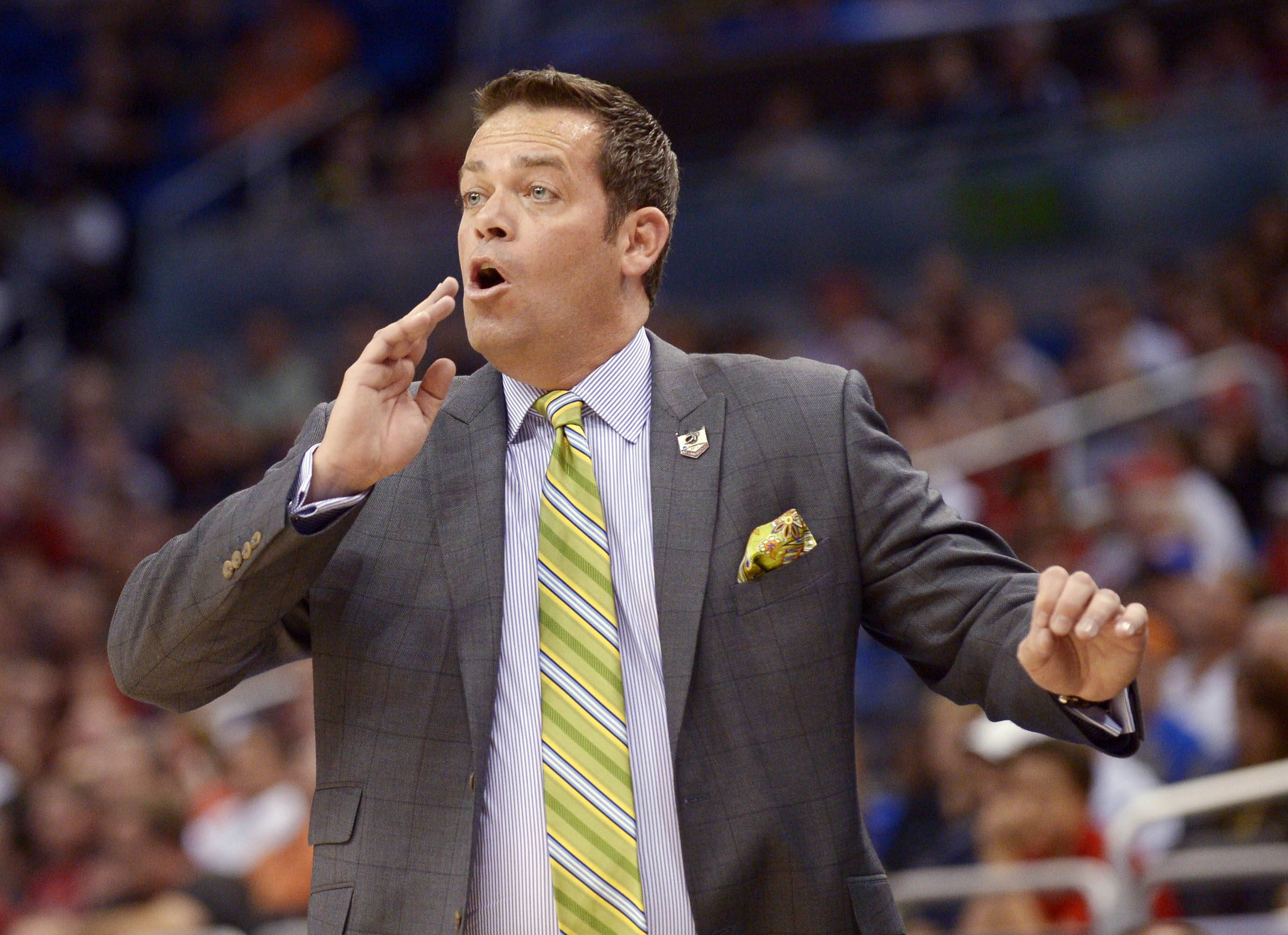 FILE - In this March 20, 2014, file photo, Manhattan coach Steve Masiello yells at his team during the first half against Louisville in a second-round game in the NCAA college basketball tournament in Orlando, Fla. South Florida's deal to hire Masiello as its new basketball coach falls apart because the rising young star doesn't have a college degree. (AP Photo/Phelan M. Ebenhack, File)