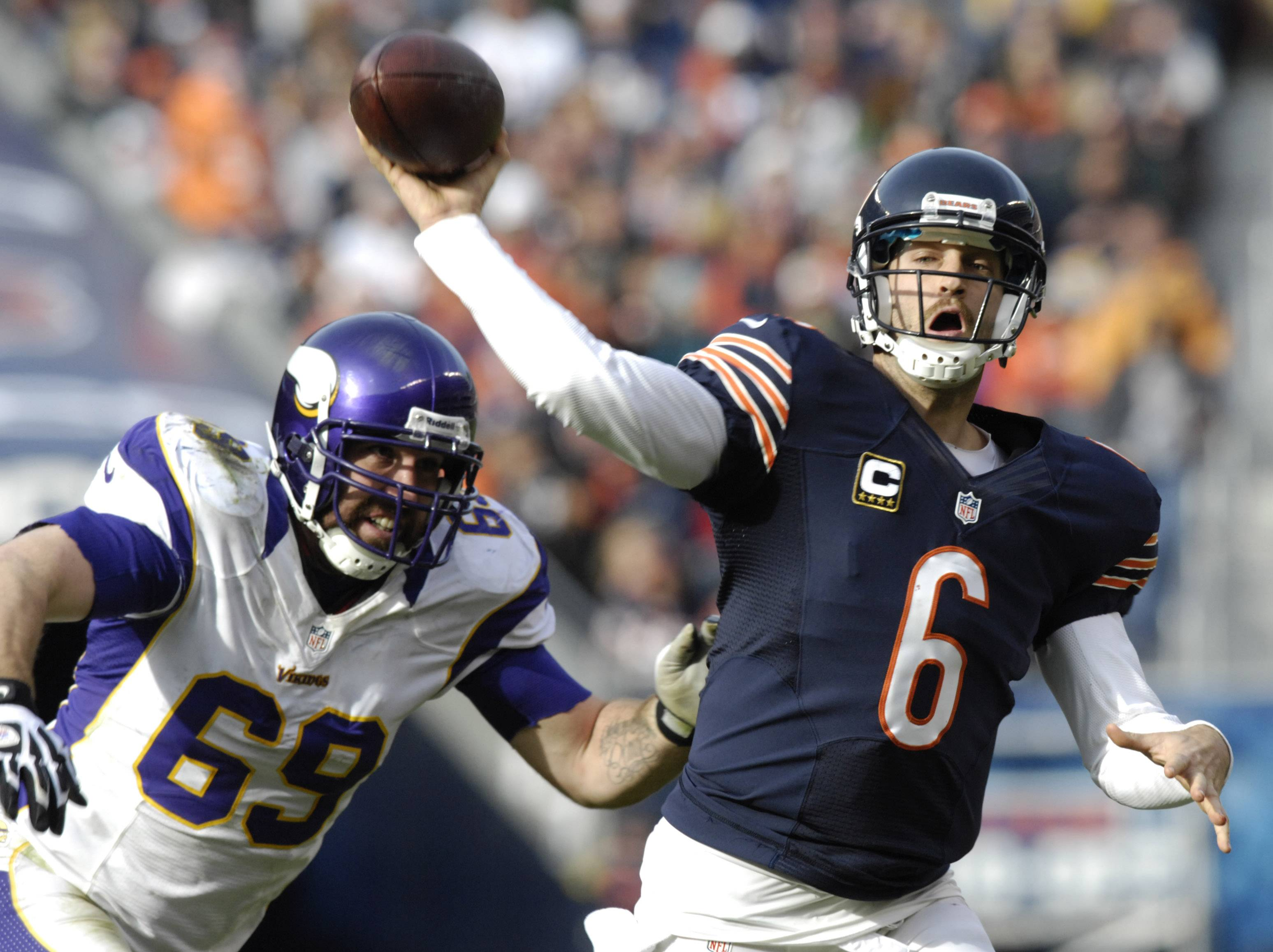 Bears quarterback Jay Cutler won't have to worry about Jared Allen chasing him down next season. Allen signed a four-year contract with the Bears on Wednesday.