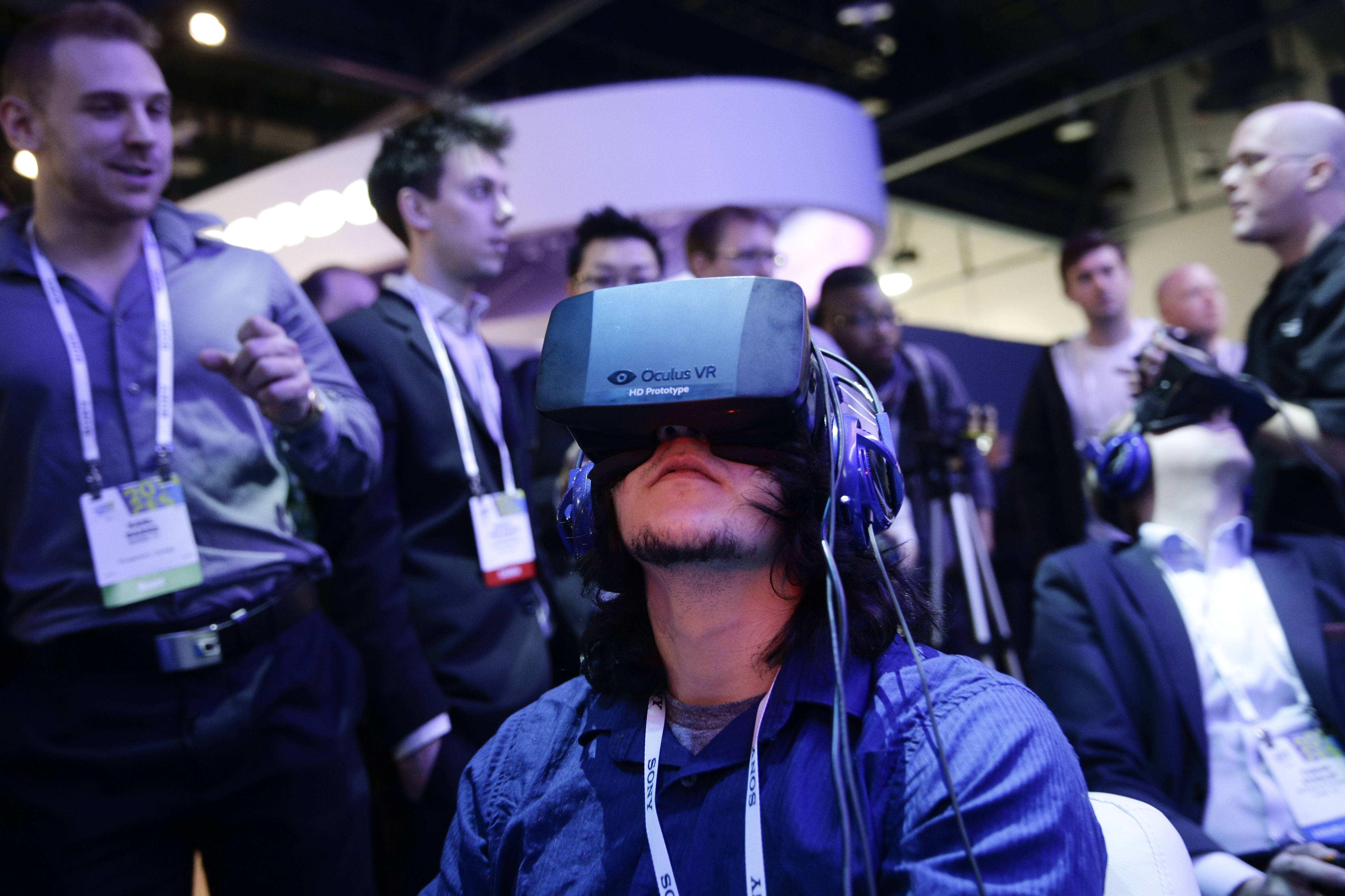 Show attendees play a video game wearing  Oculus Rift virtual reality headsets at the Intel booth at the International Consumer Electronics Showin Las Vegas.