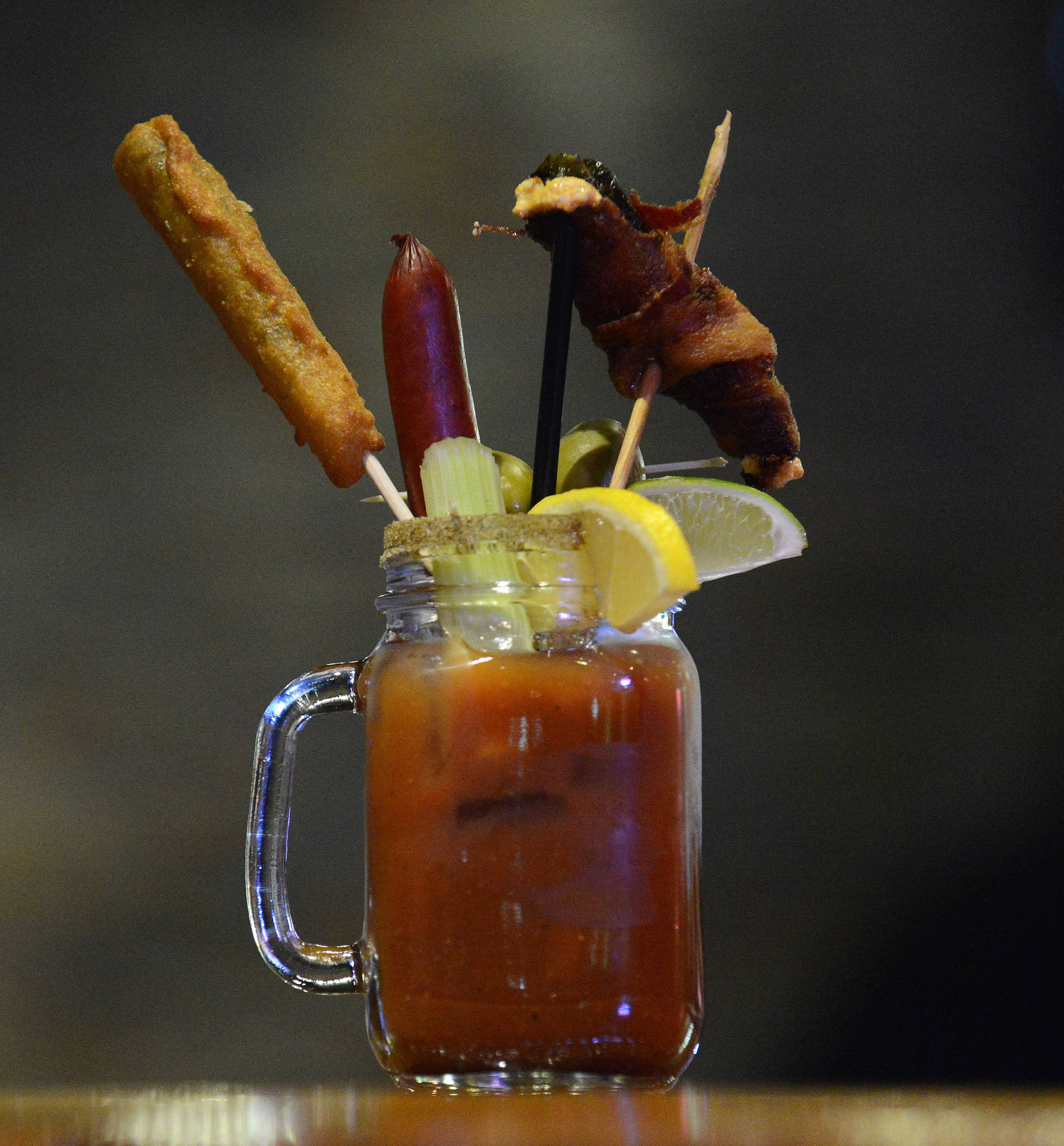 An Eddie Mary is garnished with a fried pickle, meat stick and a bacon-wrapped stuffed jalapeño at Eddie Gaedel Pub and Grill in Elburn.