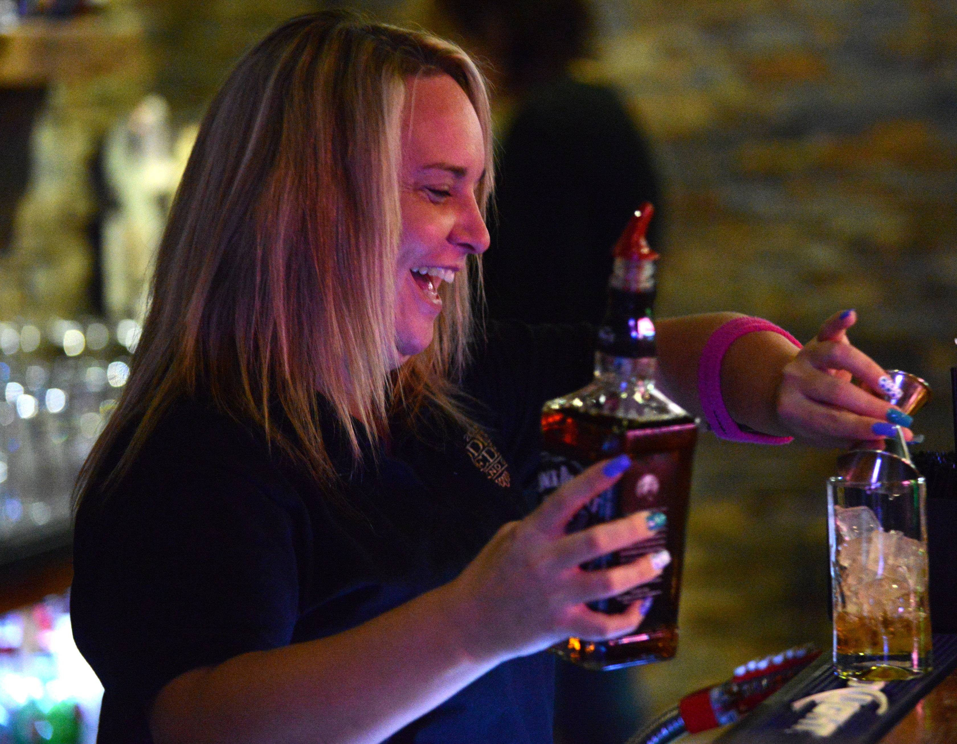 Bartender Jenny Peterson pours a drink at Eddie Gaedel Pub and Grill in Elburn.