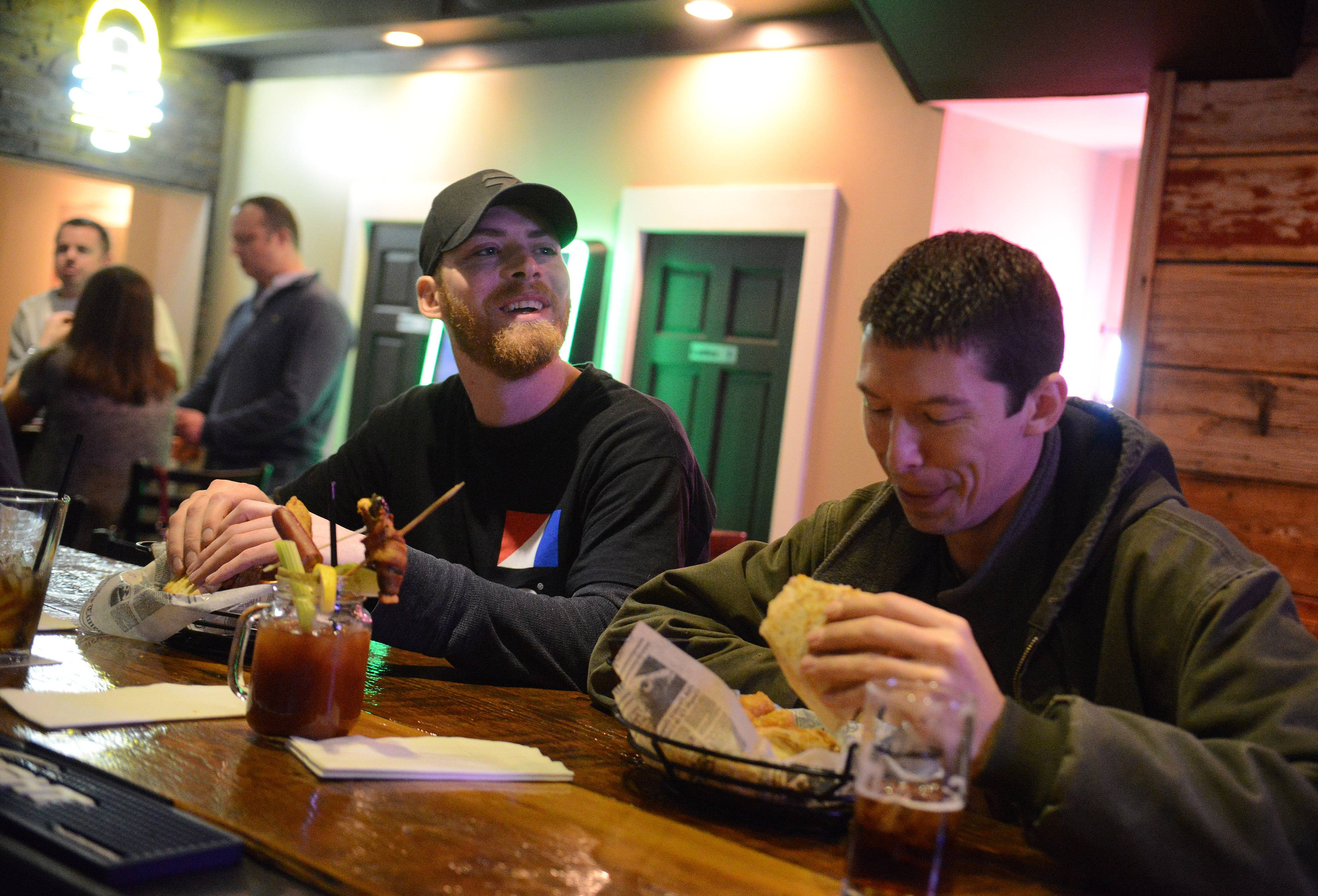 Brothers Kevin, left, and Jeff Thorne enjoy dinner at Eddie Gaedel Pub and Grill in Elburn.