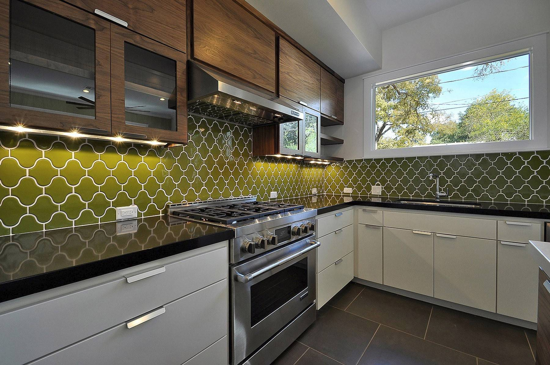 These green backsplash tiles are made of recycled materials and clay. Consider using unusual shapes and your favorite colors for a kitchen you can enjoy daily.