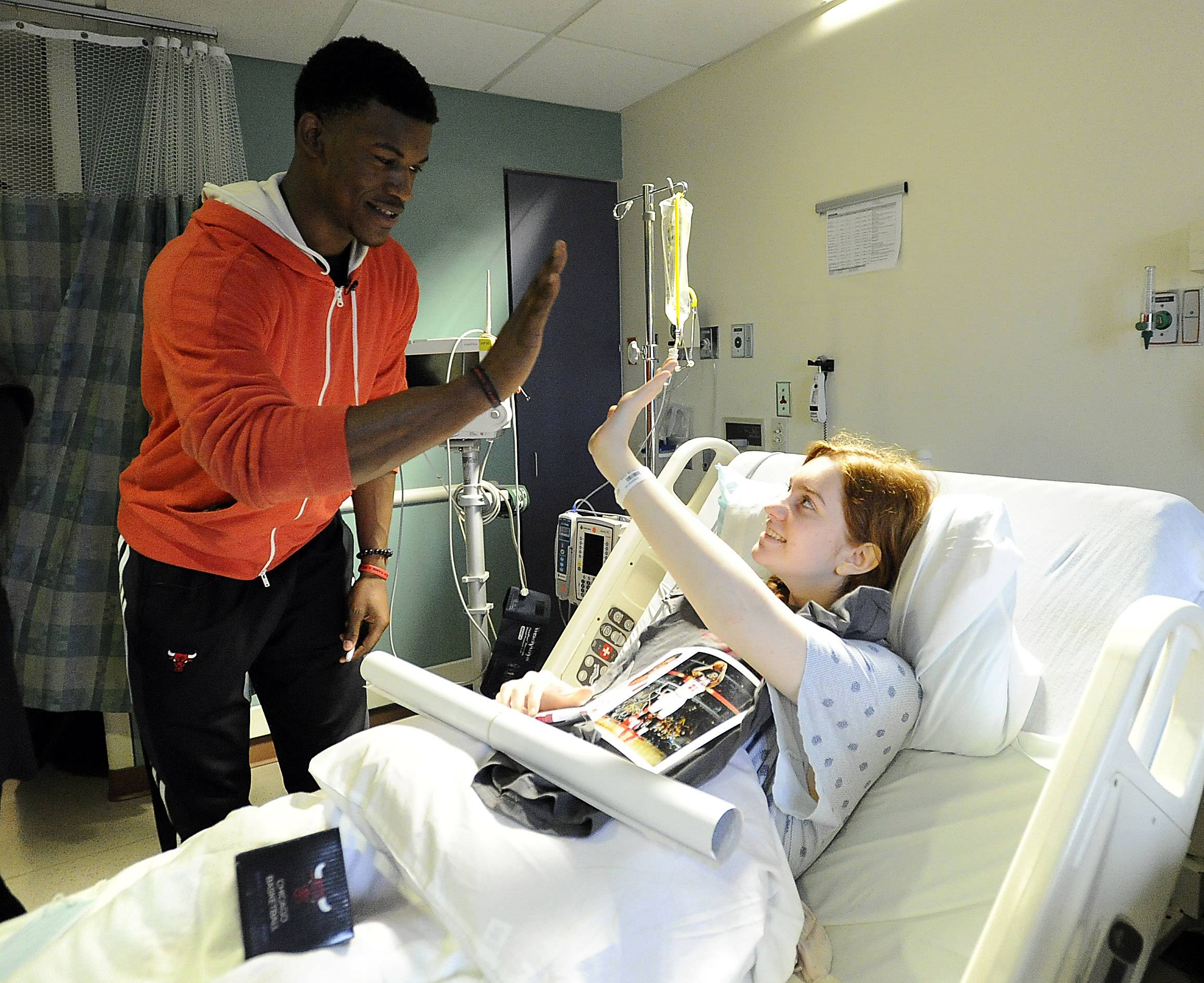 Chicago Bulls guard Jimmy Butler visits with Michelle Katz, 15, of Buffalo Grove at Lutheran General Advocate Children's Hospital in Park Ridge on Thursday.