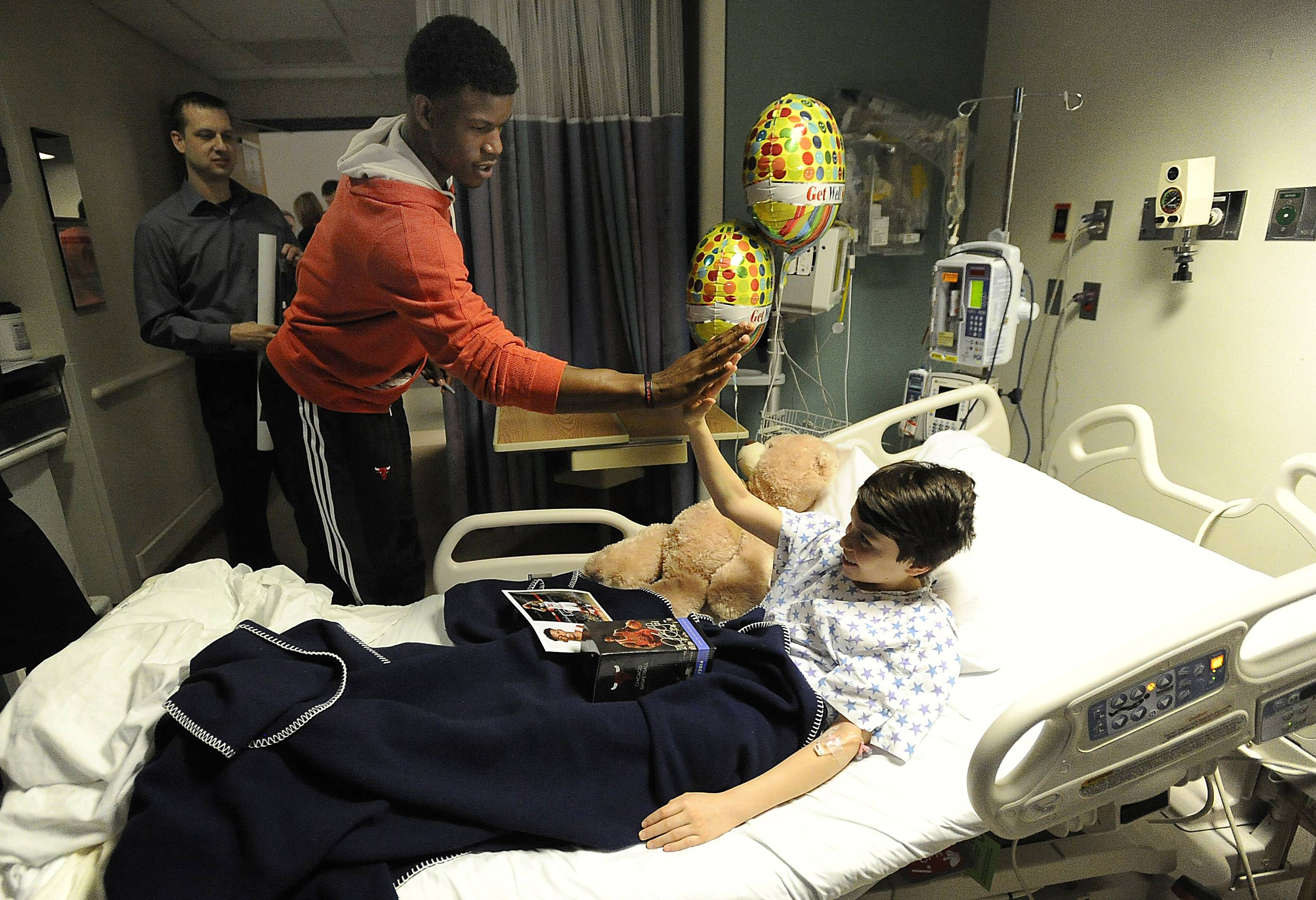Mark Welsh/mwelsh@dailyherald.comChicago Bulls guard Jimmy Butler visits with Fredy Montenadro, 14, of Mundelein at Lutheran General Advocate Children's Hospital in Park Ridge on Thursday.