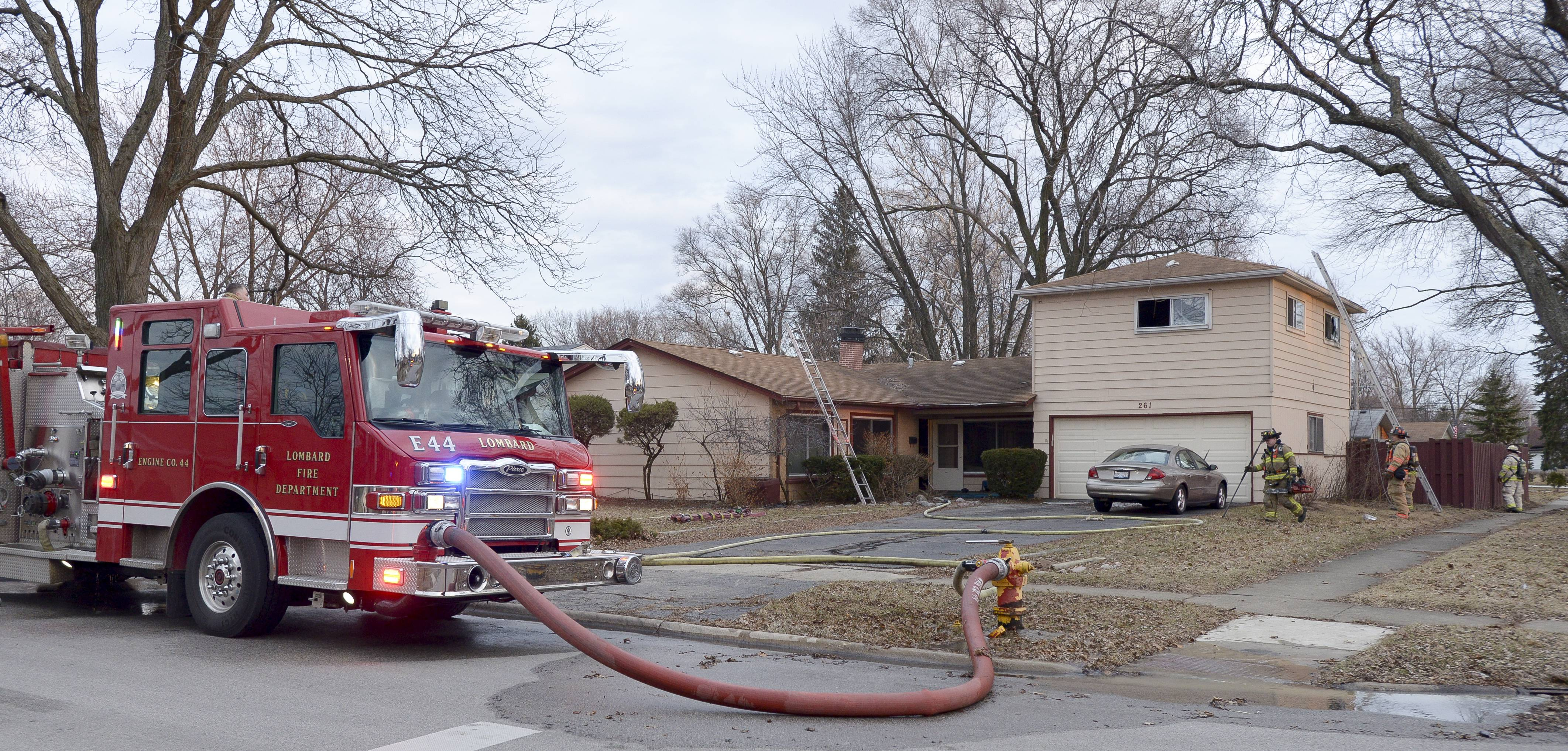 The Lombard fire department works the scene of a house fire in the 200 block of west Central Ave in Lombard.