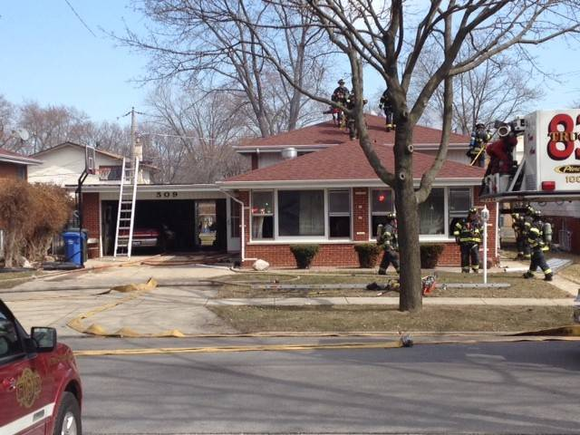 Des Plaines firefighters at the scene of a house fire on the 500 block of Westgate Road, near Fremont Street.