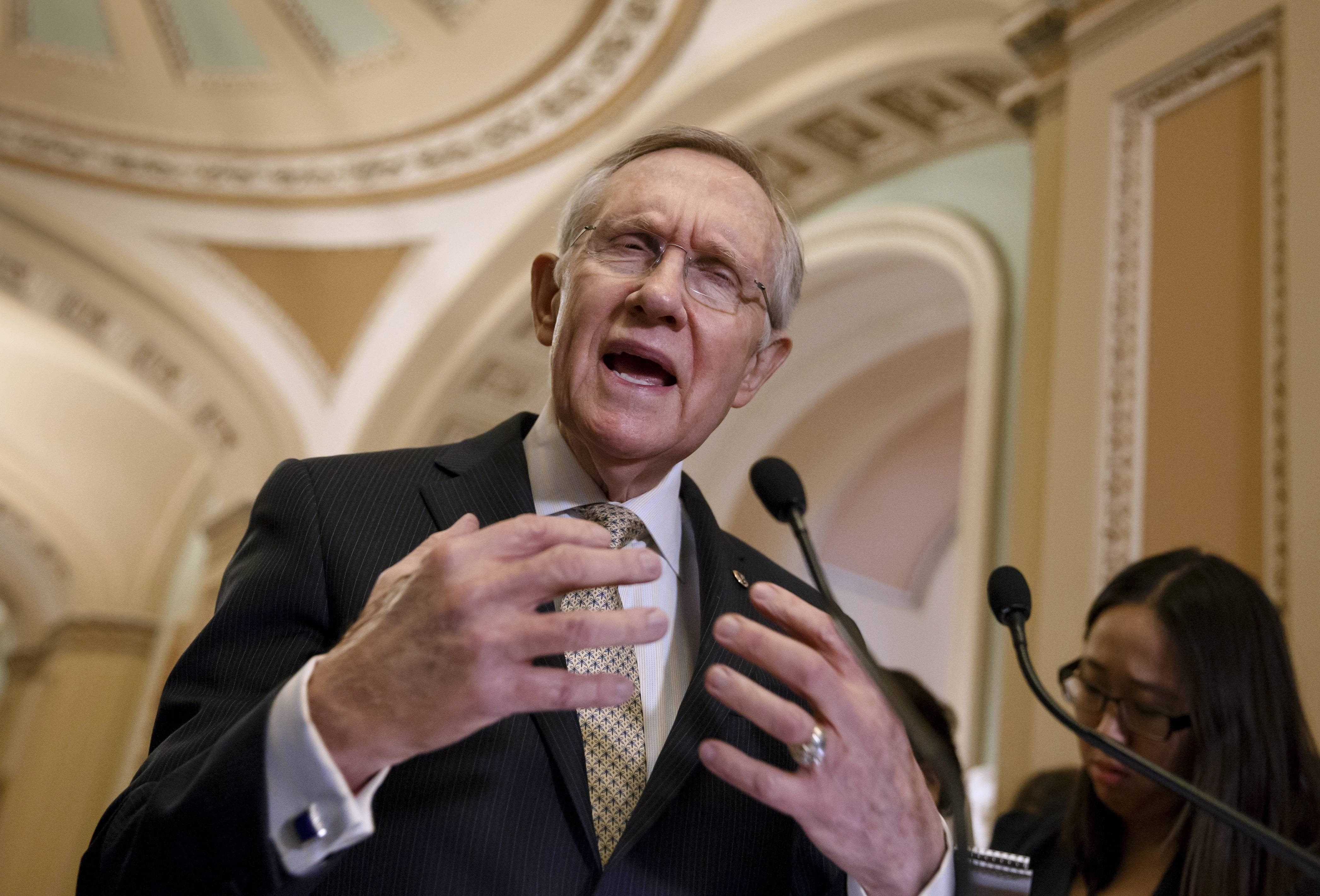 The Senate is on track to approve sanctions against Russia and aid for Ukraine after Democrats withdrew a provision that was blocking Congress from issuing a sharp response to Russian President Vladimir Putin's military intervention in Crimea.