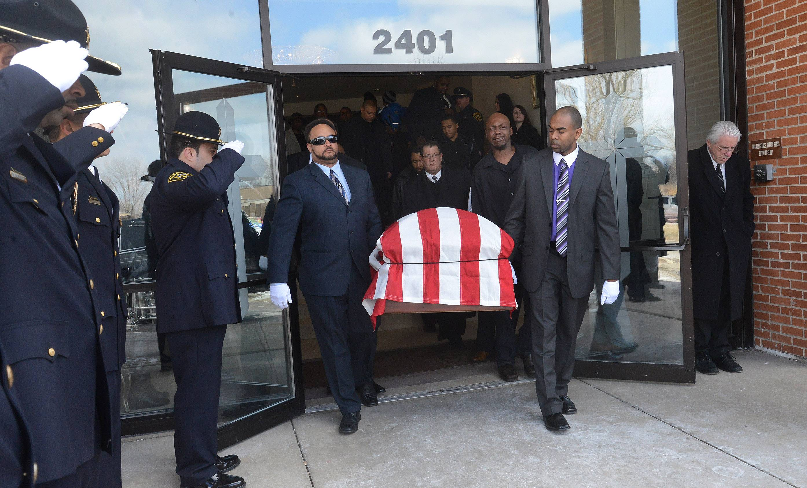 Pallbearers carry the casket of former Lake County coroner and Waukegan police chief Artis Yancey out of Mt. Sinai Institutional Baptist Church in North Chicago Tuesday afternoon. Yancey most recently served as Waukegan's city clerk.