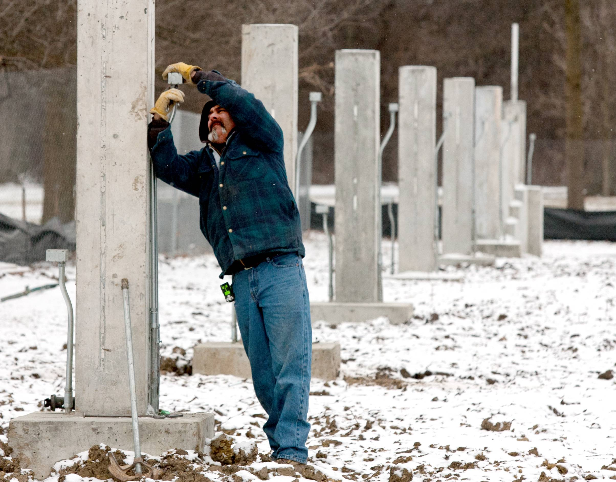 Construction on the Cantigny Park entrance continues, with hopes of finishing the project by early June. Jeff Zbreski, of Anchor Electric in Carol Stream, installs electrical boxes on each of the pillars. This is the first major upgrade to the park's entrance since it opened in the 1950s.