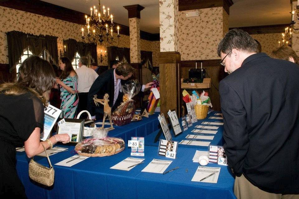 Guests at One Hope United's Blue Ribbon Event bid on items in the silent auction. The event raises money to help OHU prevent child abuse through support programs for at-risk families.