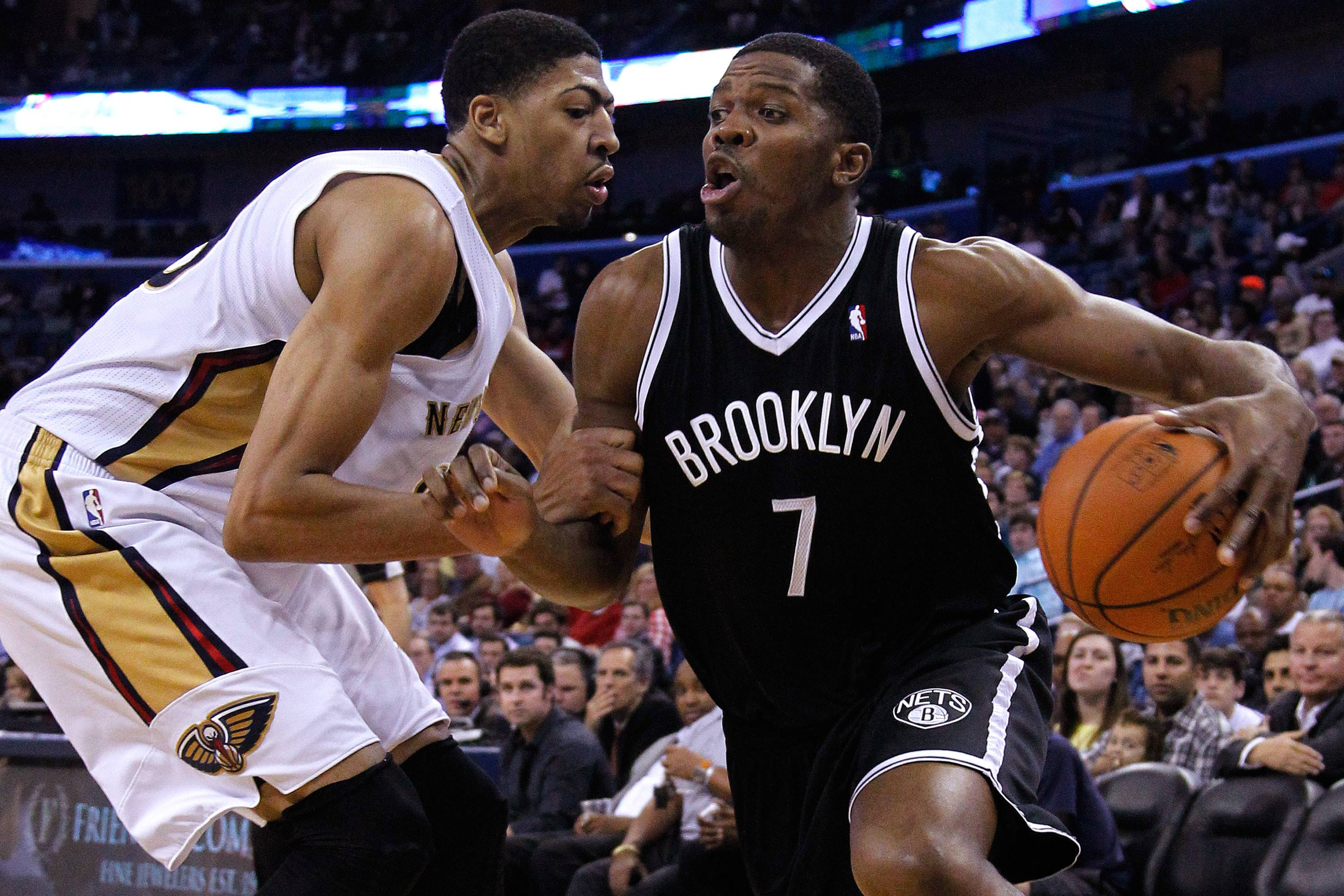 Brooklyn Nets guard Joe Johnson (7) drives against New Orleans Pelicans forward Anthony Davis, left, during the first half of an NBA basketball game in New Orleans, Monday, March 24, 2014. The Pelicans won 109-104.