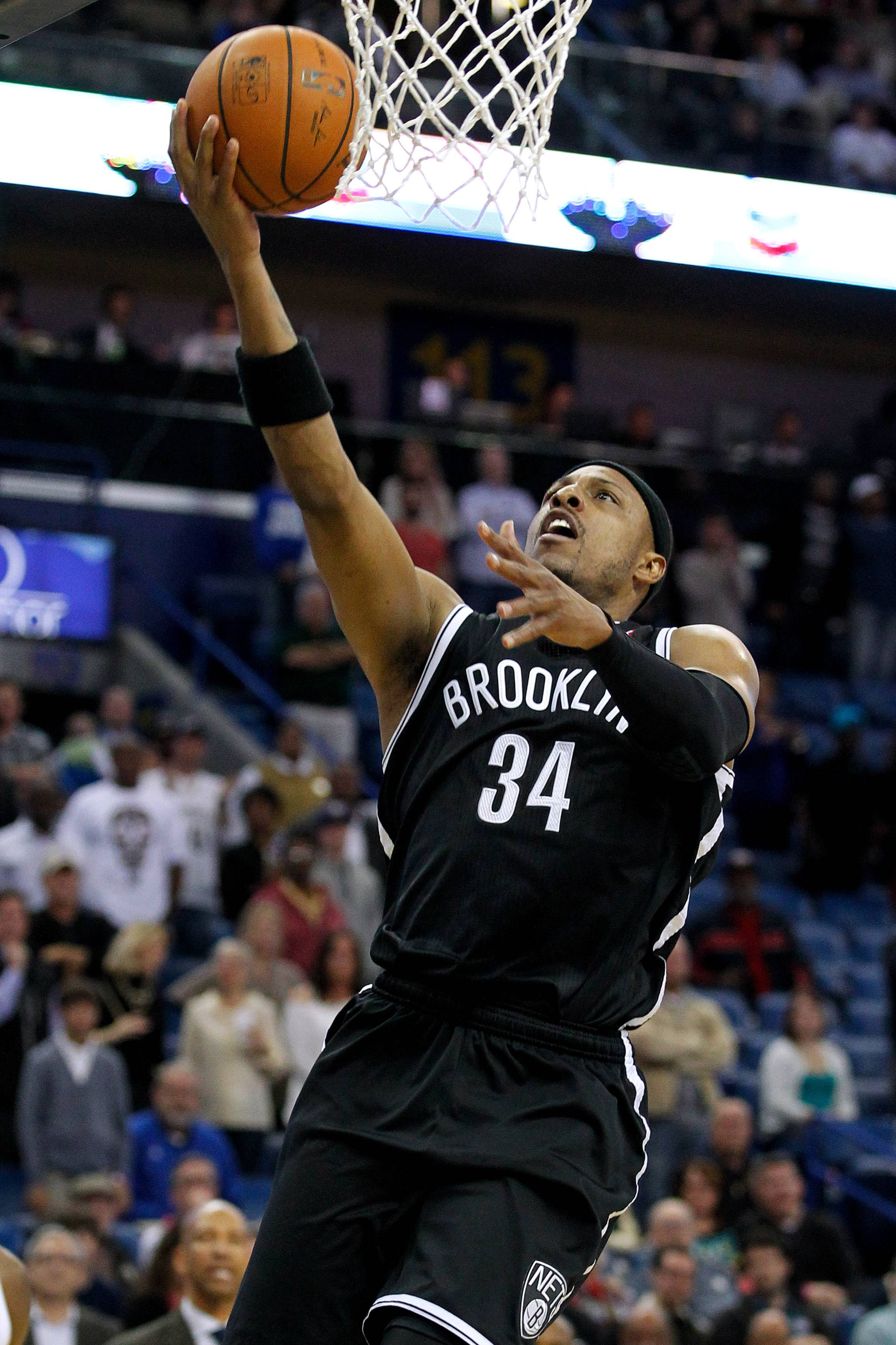 Brooklyn Nets forward Paul Pierce (34) shoots the ball during overtime of an NBA basketball game against the New Orleans Pelicans in New Orleans, Monday, March 24, 2014. The Pelicans won 109-104.