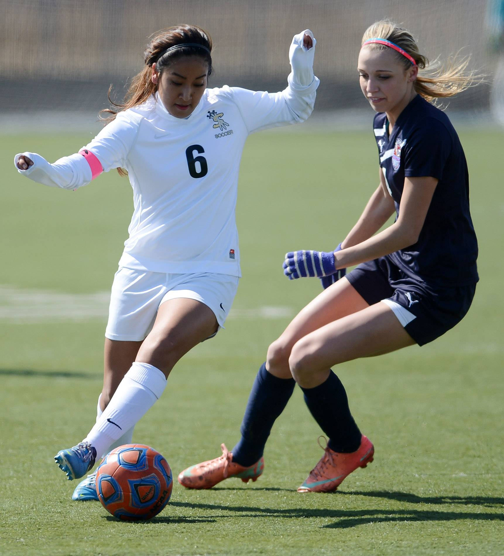 Streamwood's Erika Delgado tries to cut past South Elgin's Savanah Uveges during soccer action in Streamwood Wednesday.
