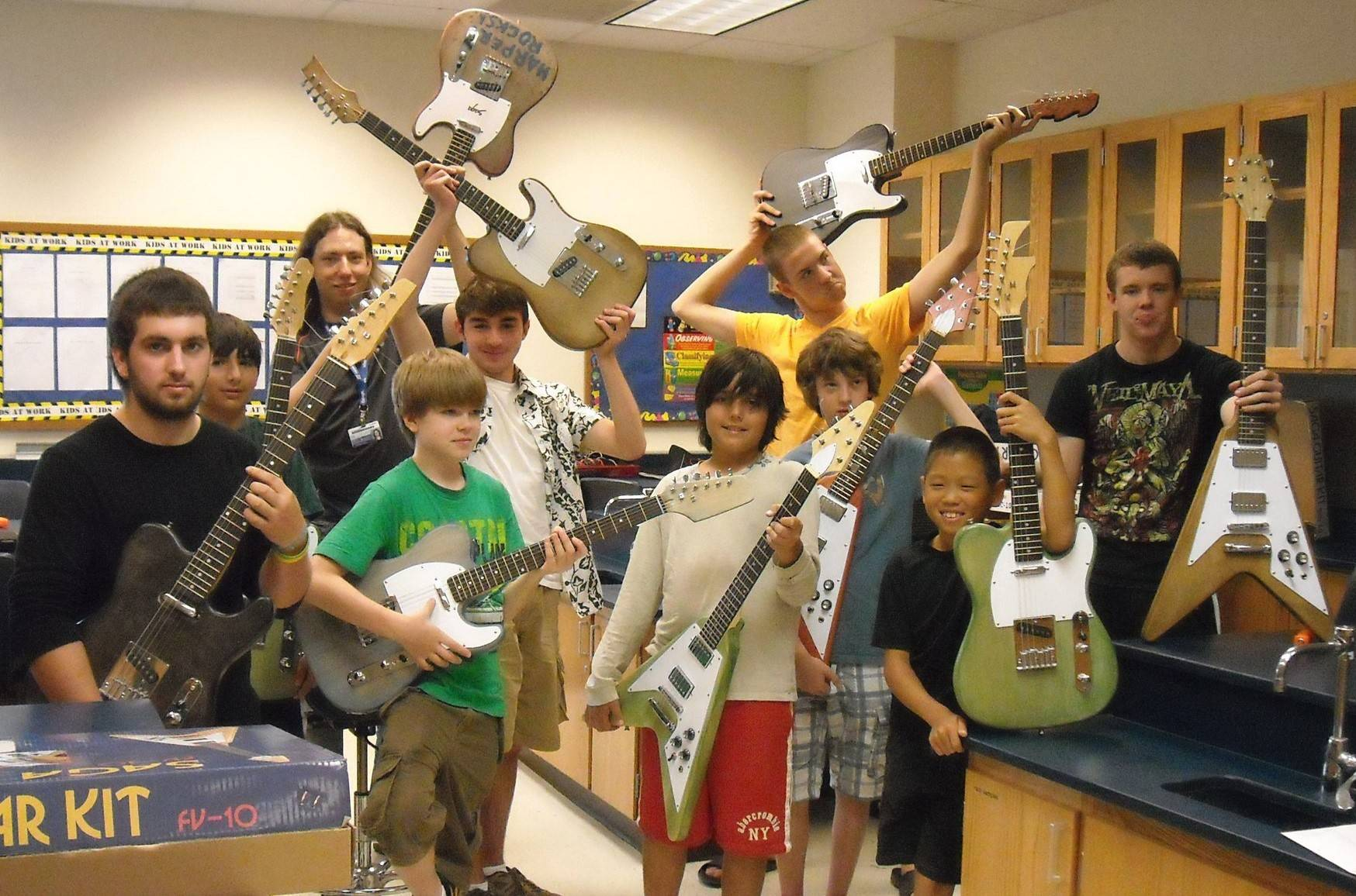 InZone students in the Build Your Own Guitar class show off their work.