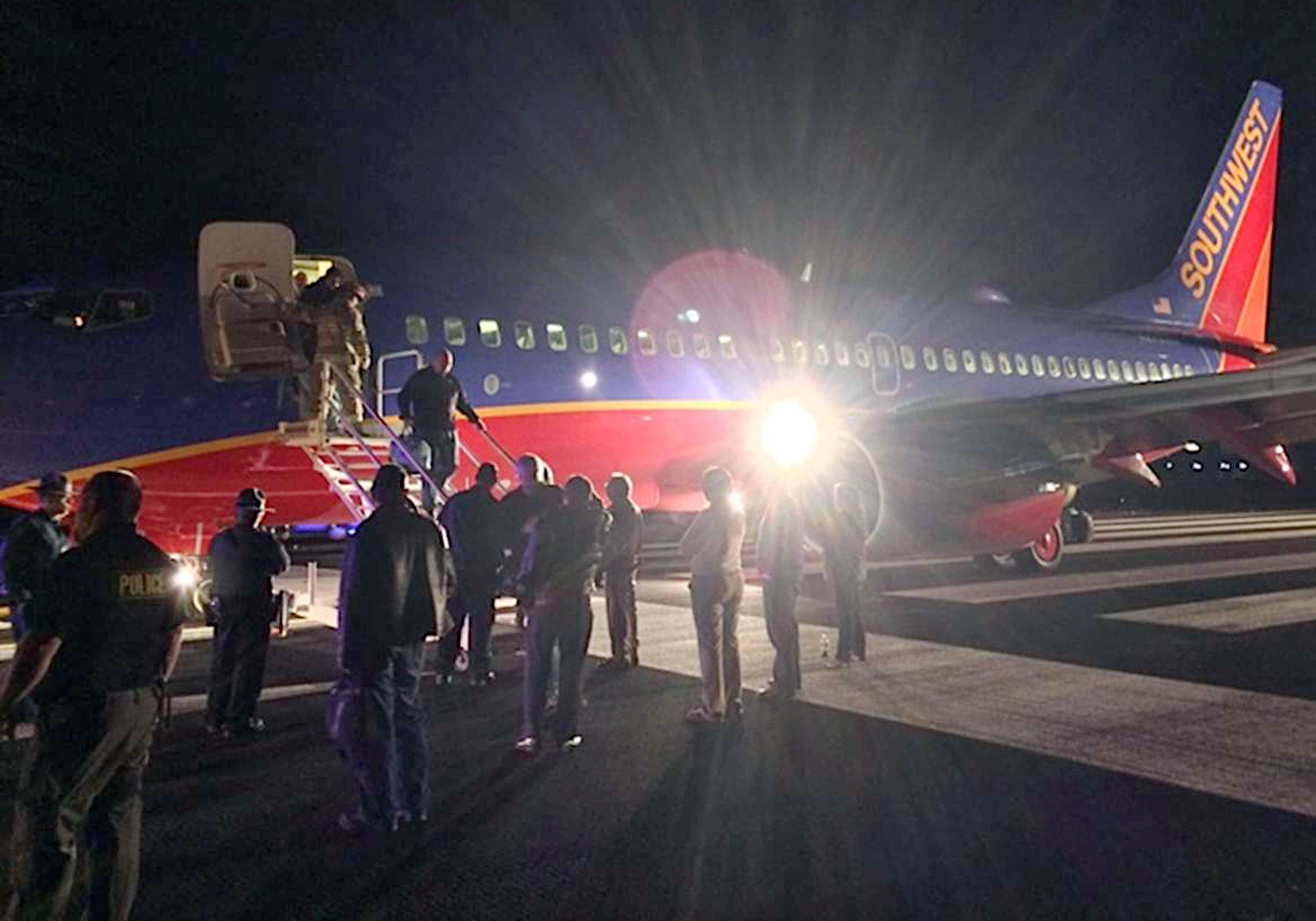 Passengers exit a Southwest Airlines flight after it mistakenly landed at a small airport in Hollister, Mo., rather than one several miles away in Branson. File)