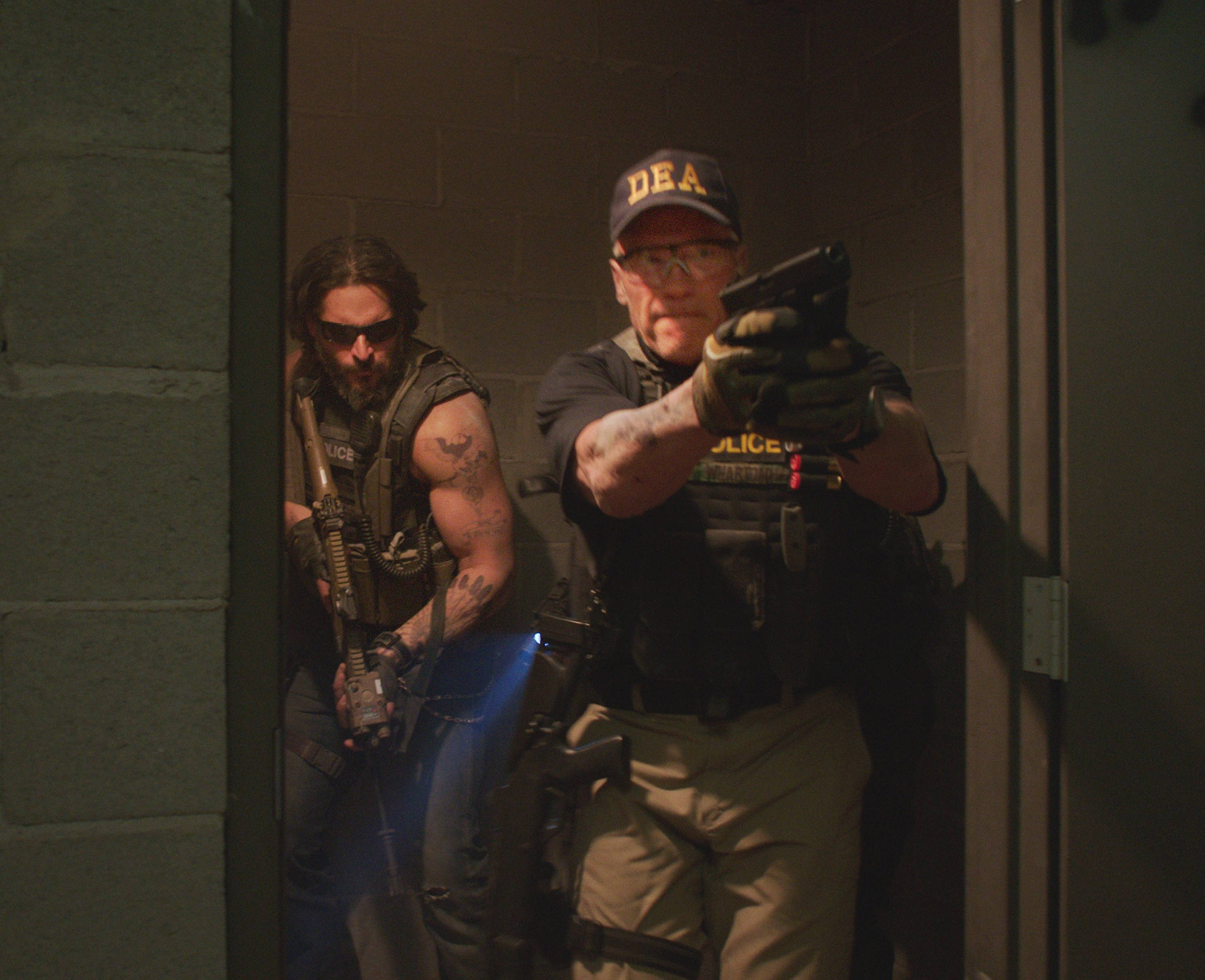 "Grinder (Joe Manganiello) and Breacher (Arnold Schwarzenegger) hunt down members of a drug cartel in ""Sabotage."""